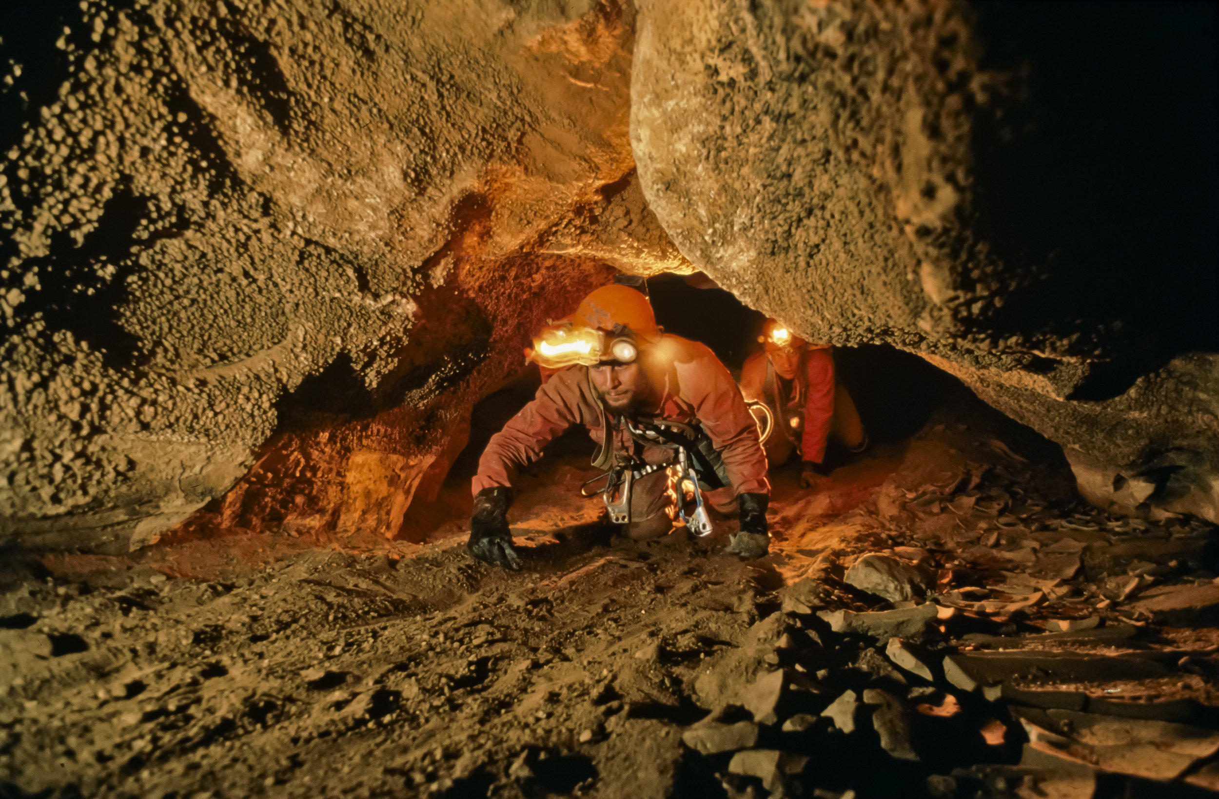 "Porter and Sloan begin the 70m long ""sand crawl"" in upper San Agustin. Photo by U. S. Deep Caving Team/Wes Skiles."