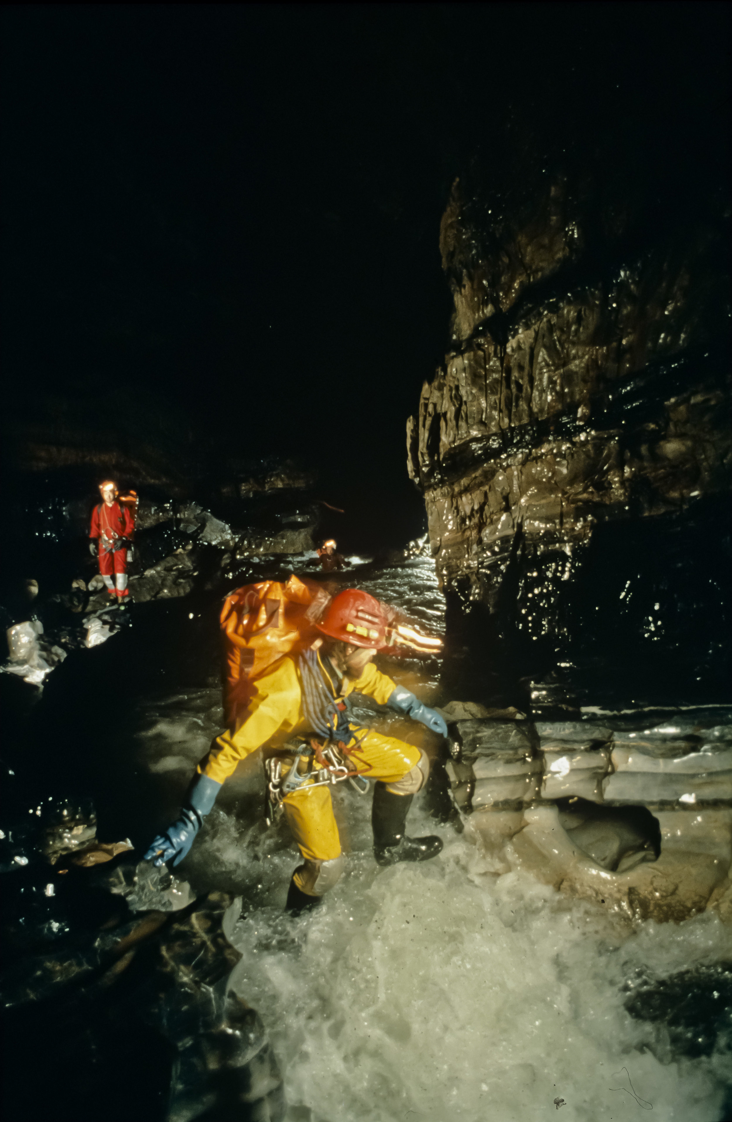 """A string of cavers travels upstream from Camp 3 in """"The Metro"""" at 760m in San Agustin. Photo by U. S. Deep Caving Team/Wes Skiles."""