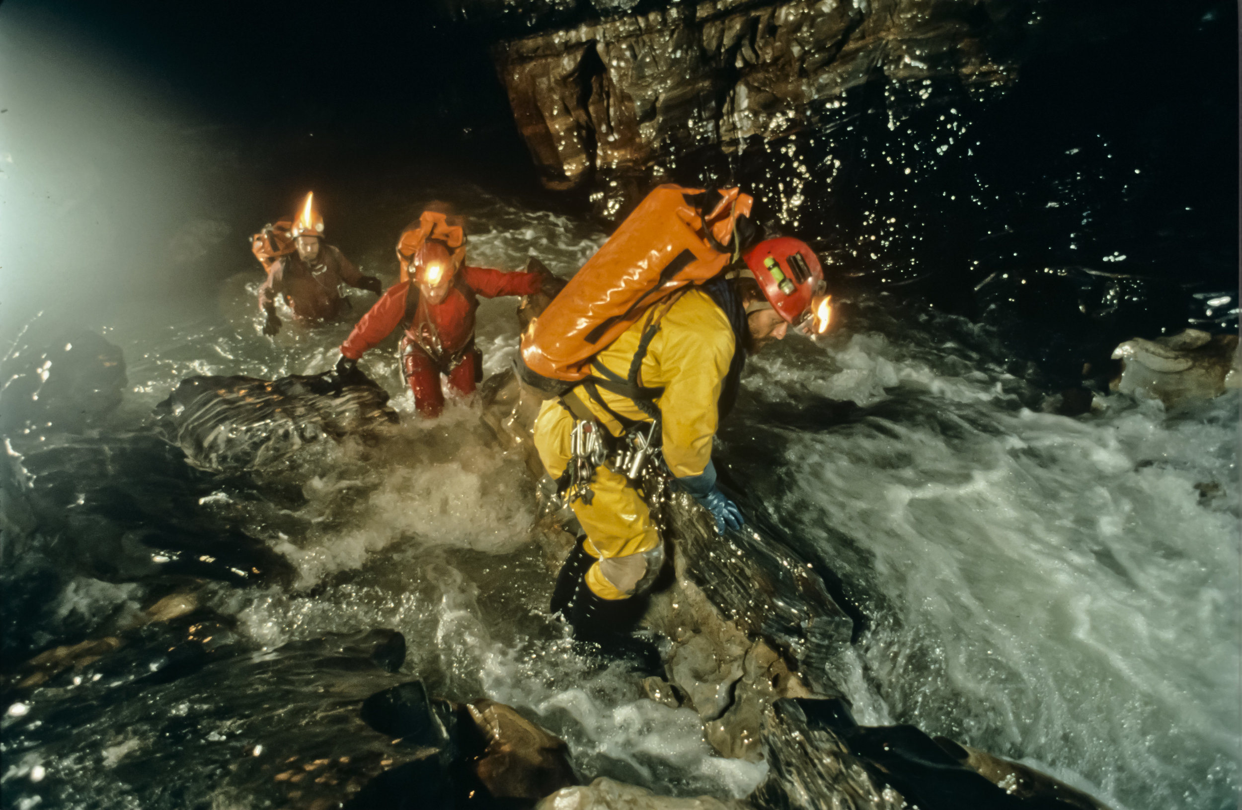 "Lead photo for the National Geographic story, September 1995 issue. The caption read ""Caught in a raging runoff that fell as rain 2,500 feet [760m] above them, explorers struggle for balance within the Huautla cave system. Photo by U. S. Deep Caving Team/Wes Skiles."