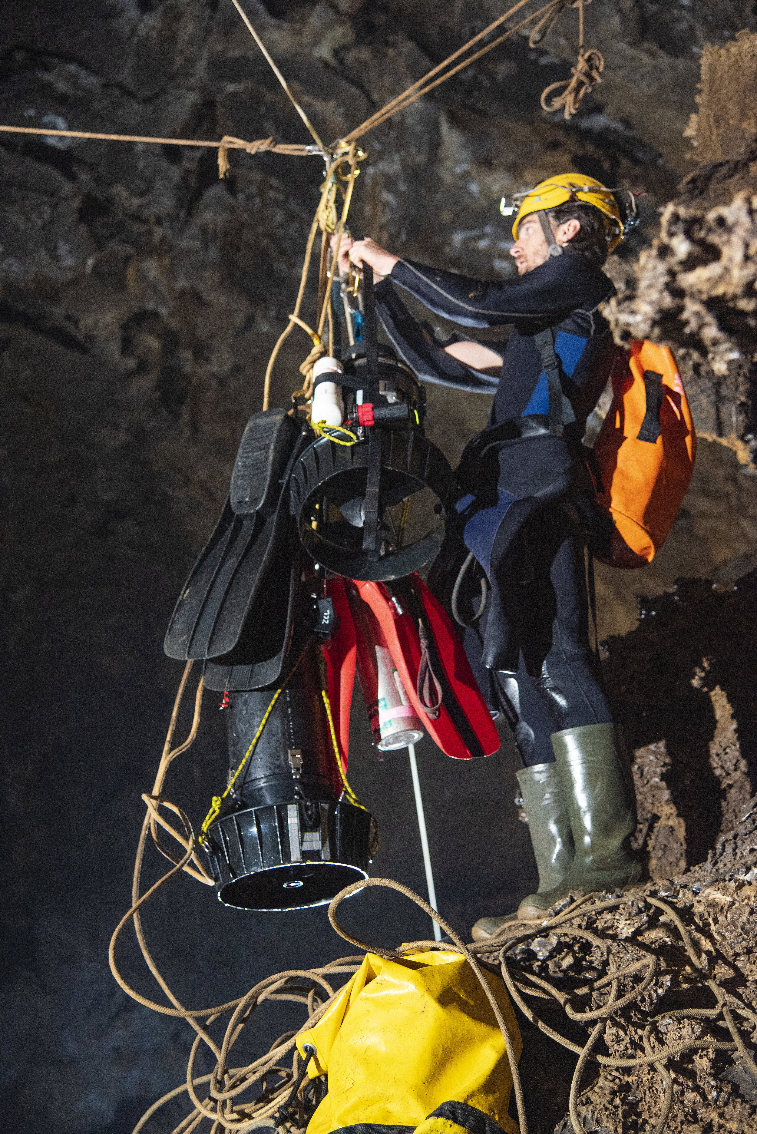 Jon Lillestolen moving dive gear along the tyroleans between the sumps. Photo by Adam Haydock.