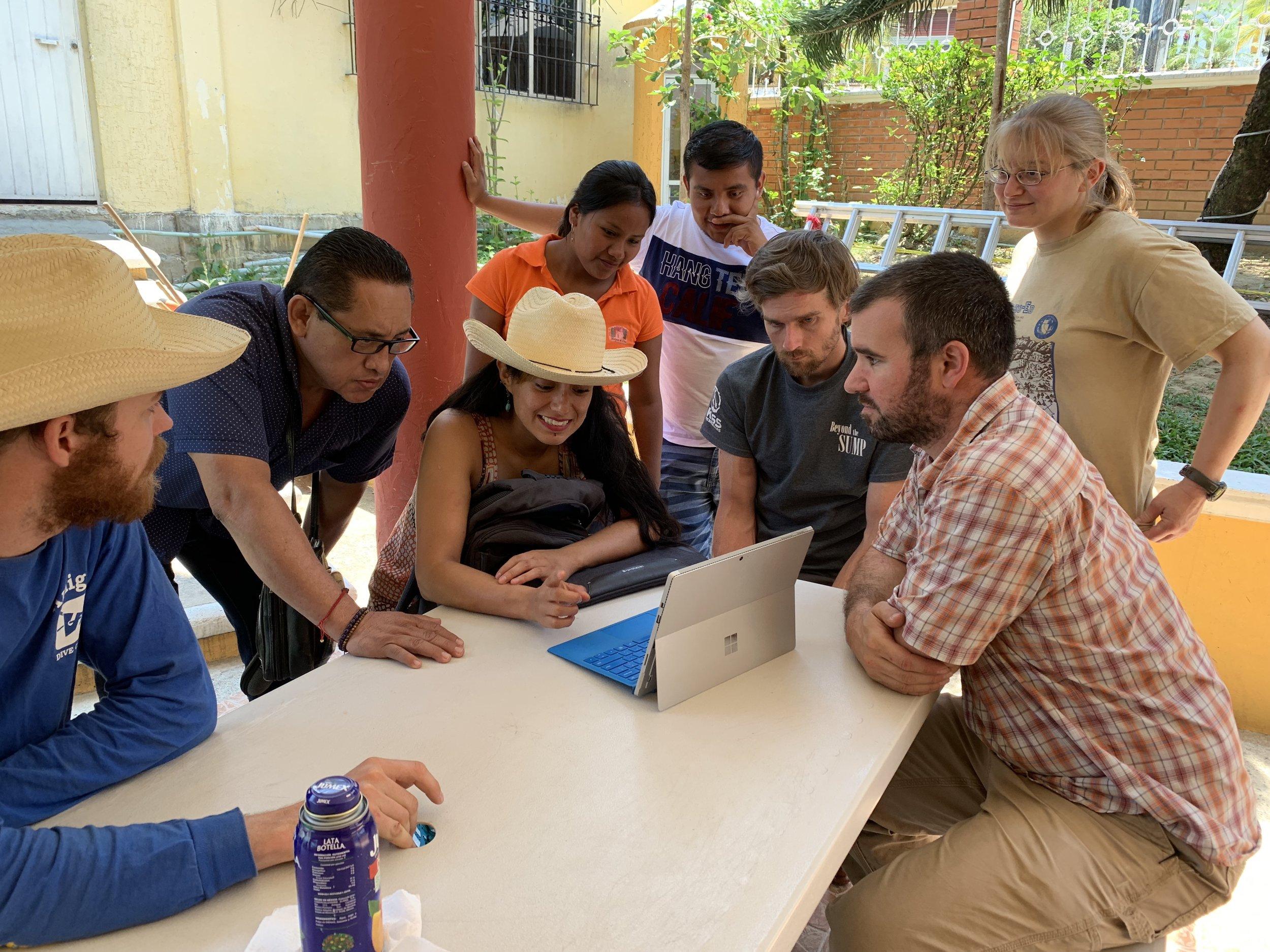 The team presenting photos and videos to officials of San Felipe Jalapa de Díaz. Photo by Teddy Garlock.
