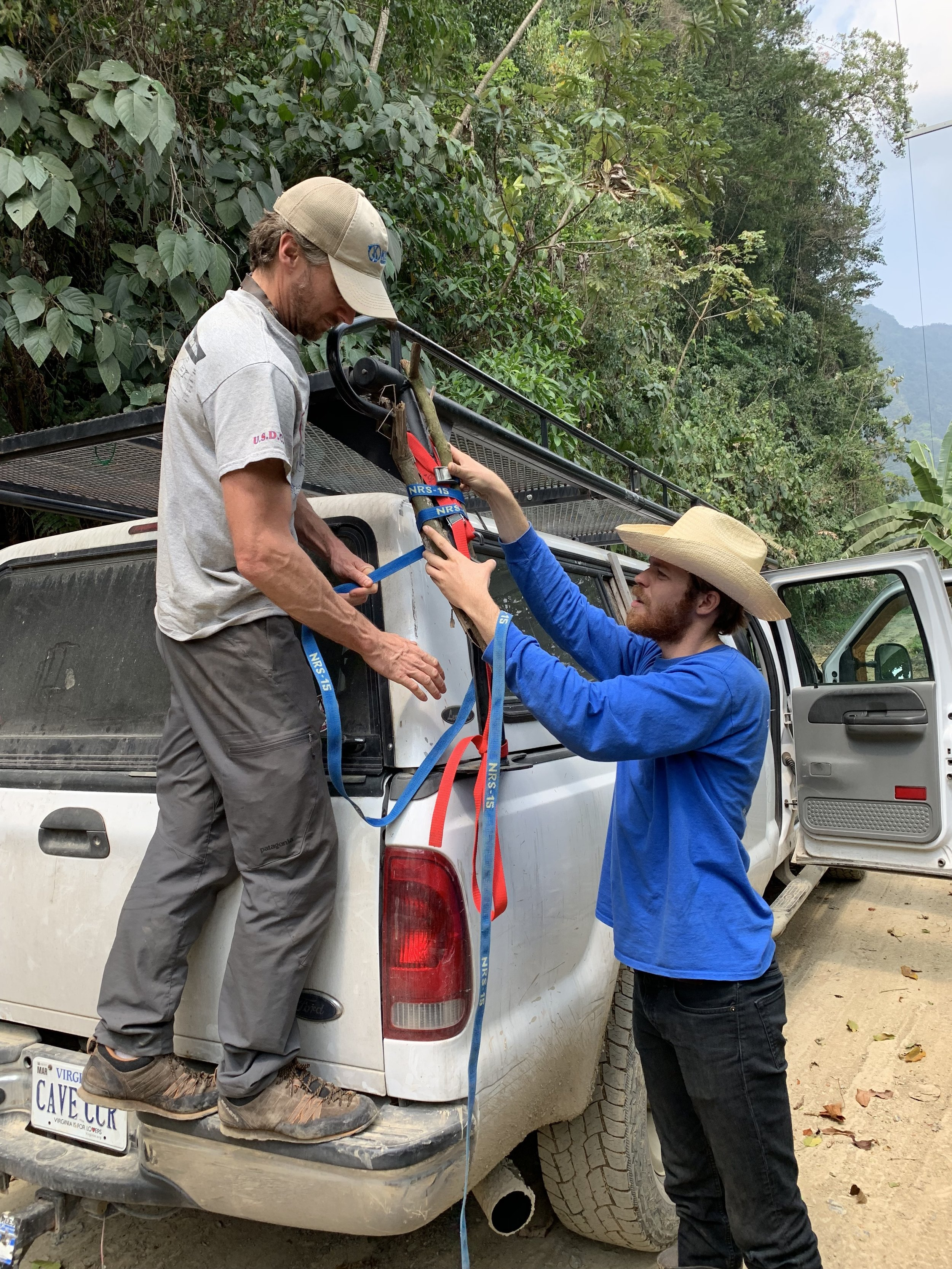 Jon Lillestolen and Steve Lambert fixing the roof rack on the expedition truck. Photo by Teddy Garlock.