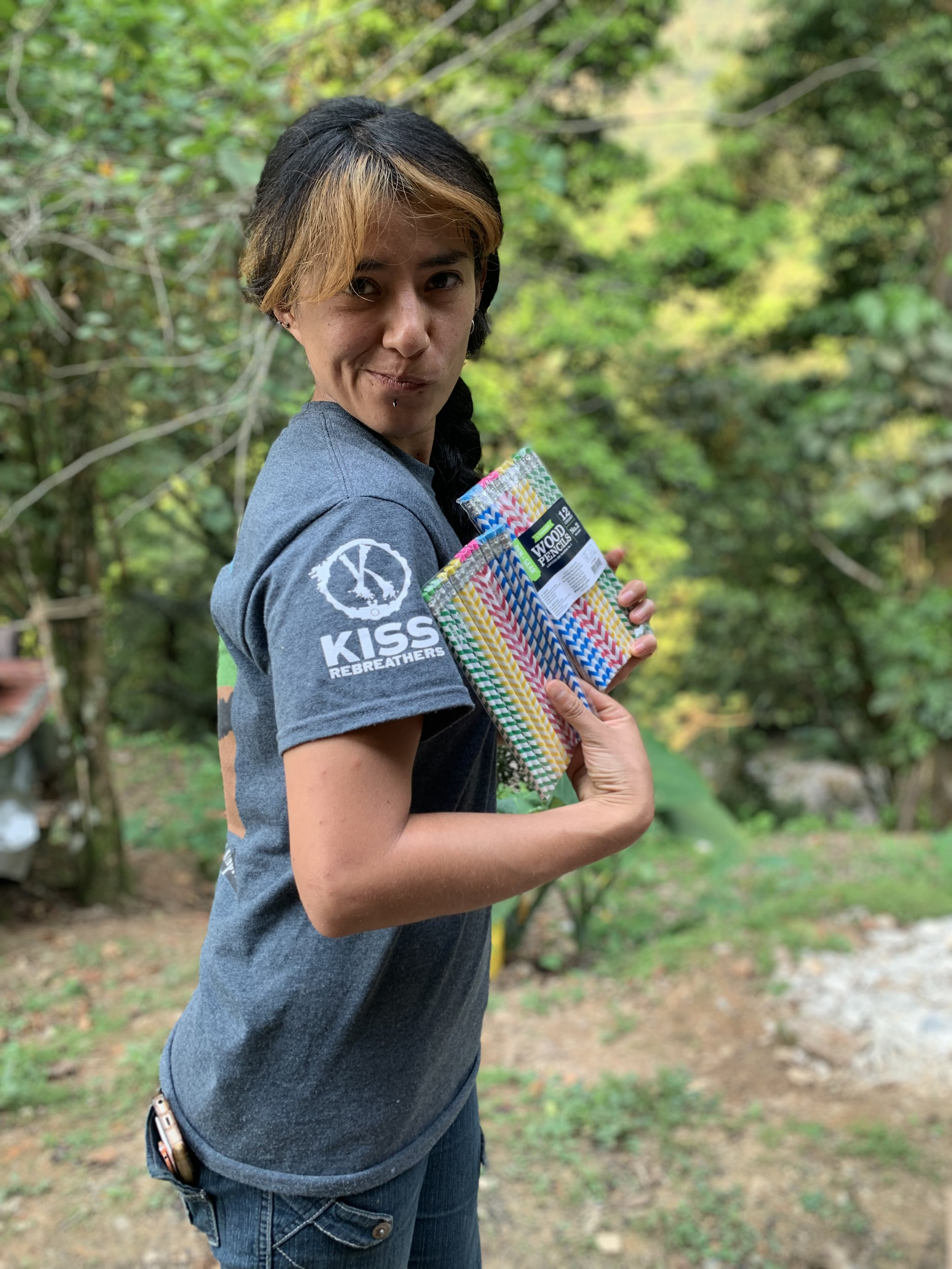 Alejandra Mendoza showing off some school supplies we gave to the local kids. Photo by Teddy Garlock.