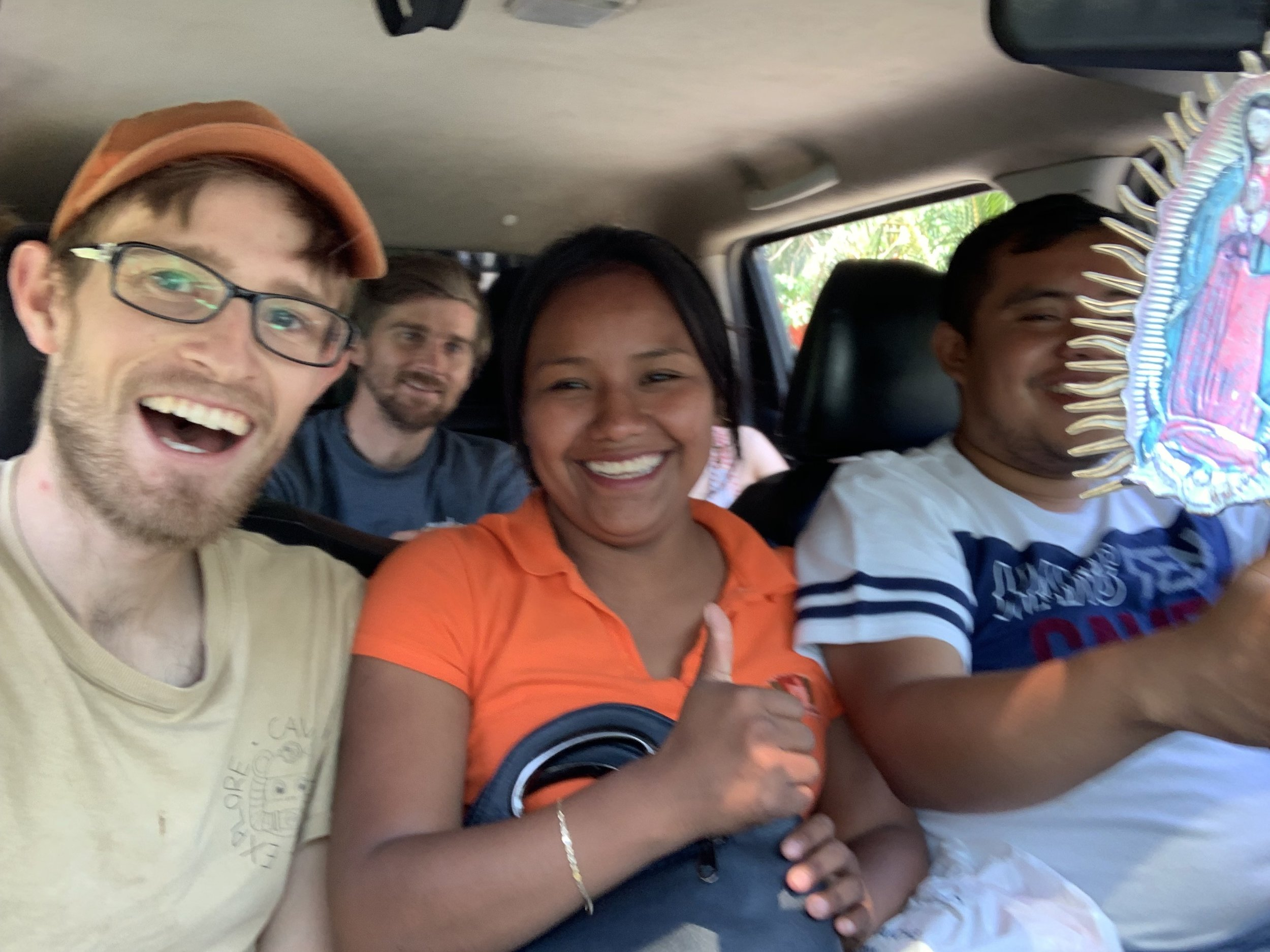 Teddy Garlock, tourism officer Tatiana López, and Jon Lillestolen in the expedition truck. Photo by Teddy Garlock.