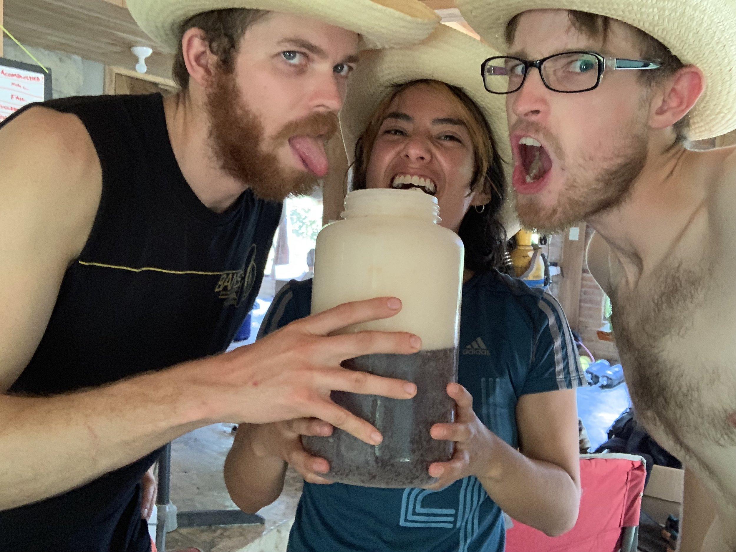 Steve Lamebrt, Alejandra Mendoza, and Teddy Garlock drinking beer out of 4l Nalgene containers. Photo by Teddy Garlock.
