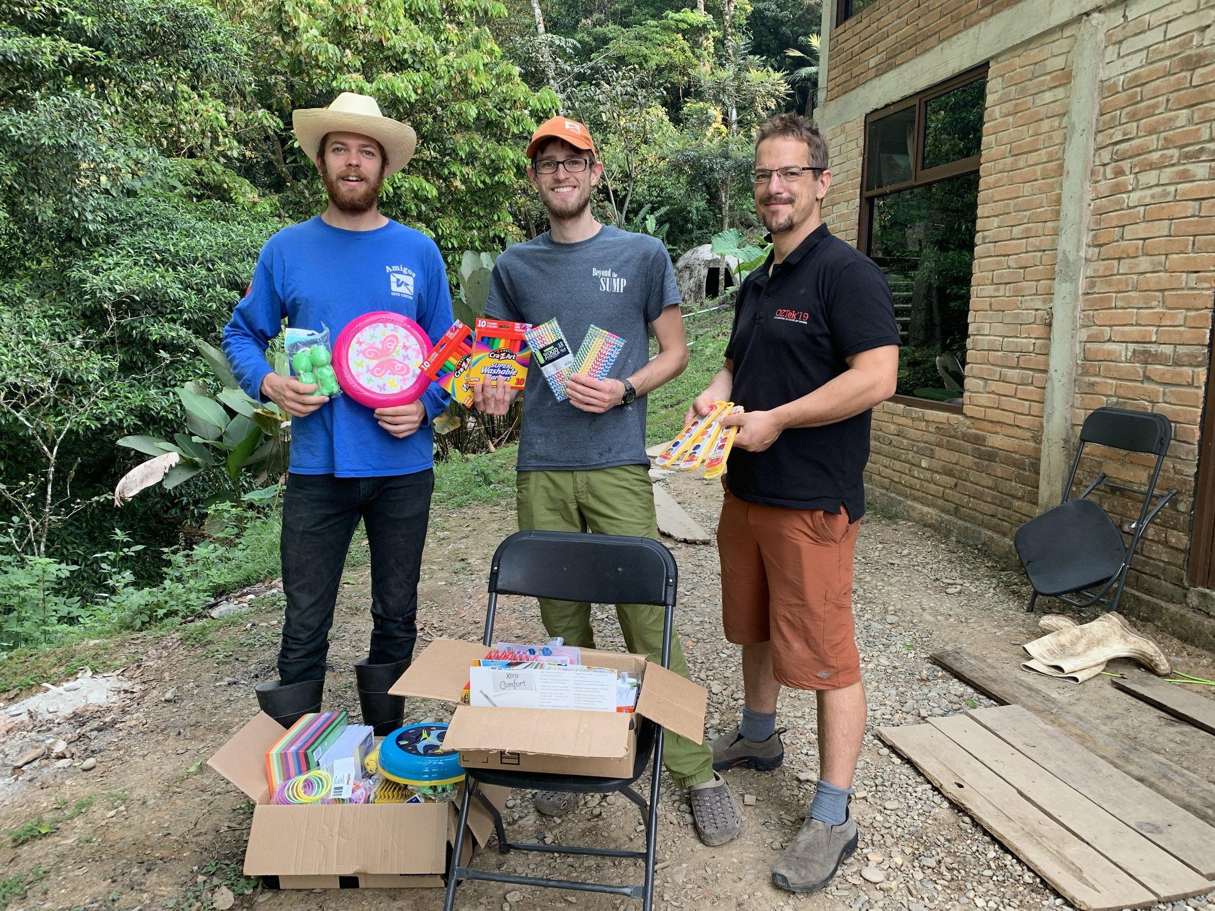 Steve Lambert, Teddy Garlock, and Andreas Klocker with school supplies for the local kids.