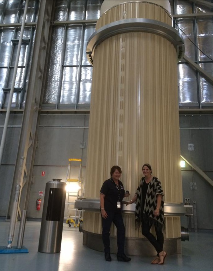 Meagan Lienert of Kimba and  Marion Jones , ANSTO, in front of the cask of final waste.