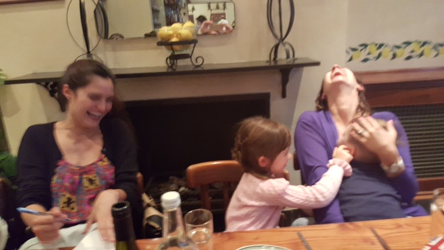 Laughing so hard the photo's blurry - a dinner out in London with Mileska and the kids