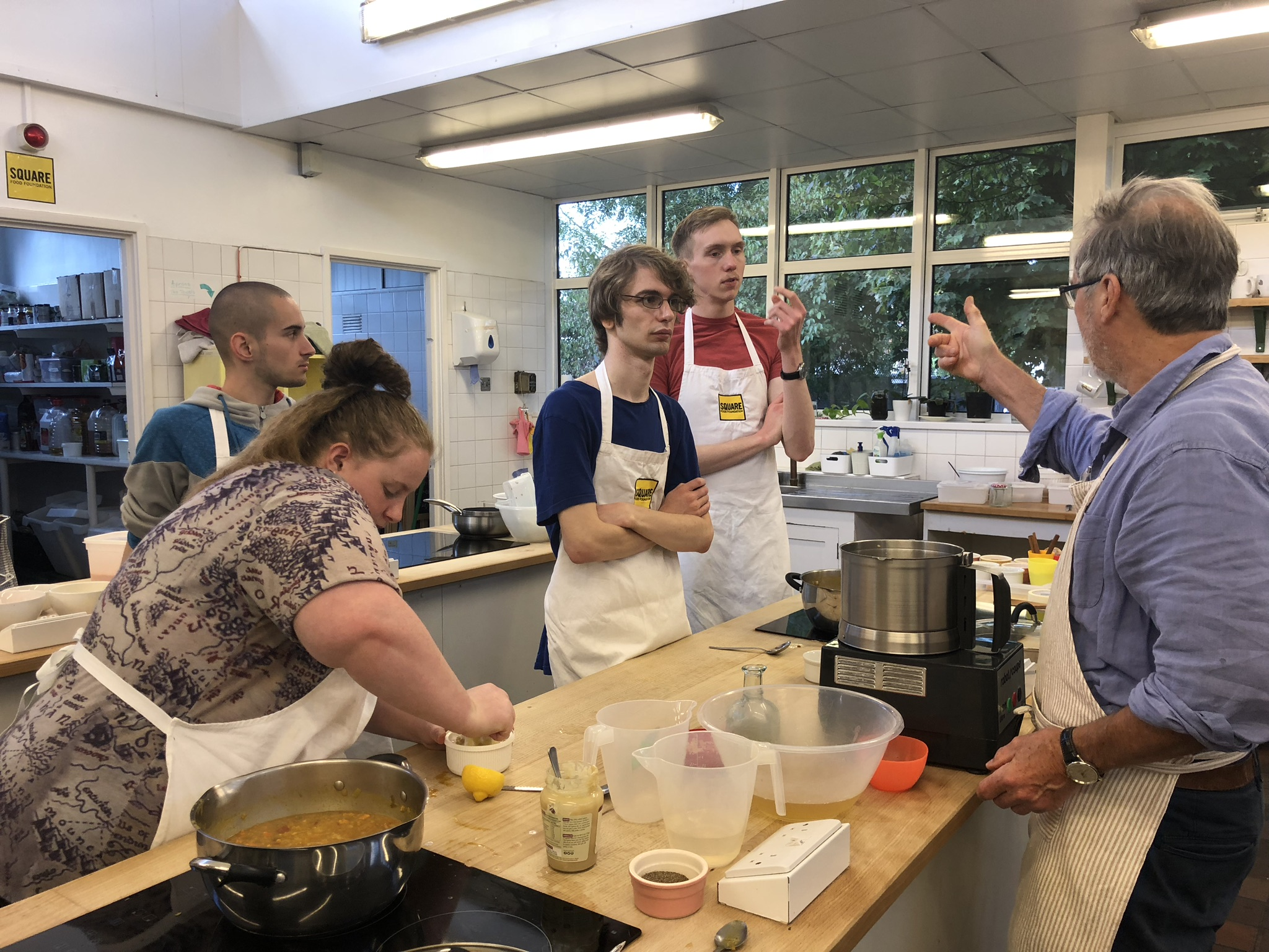 The current cohort on the young chefs programme, learning to cook at Square Food Foundation.jpeg