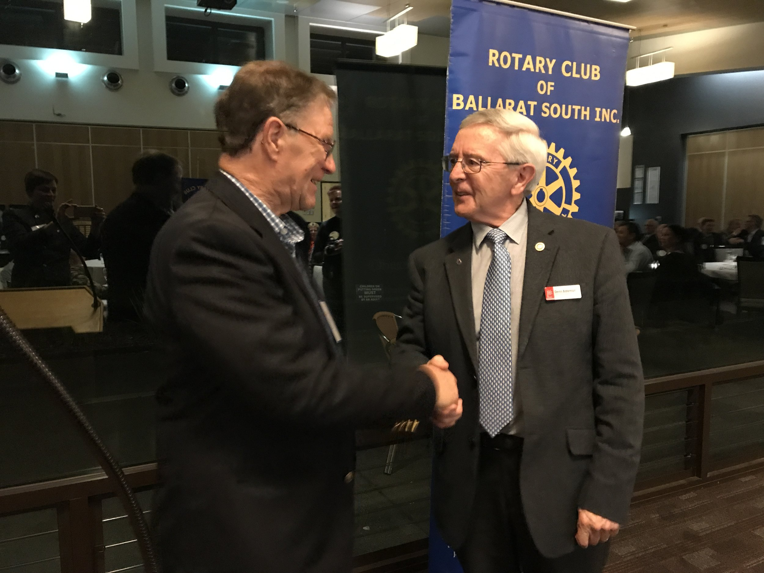 Dr Tony Cole being congratulated on his prize by Denis Bateman
