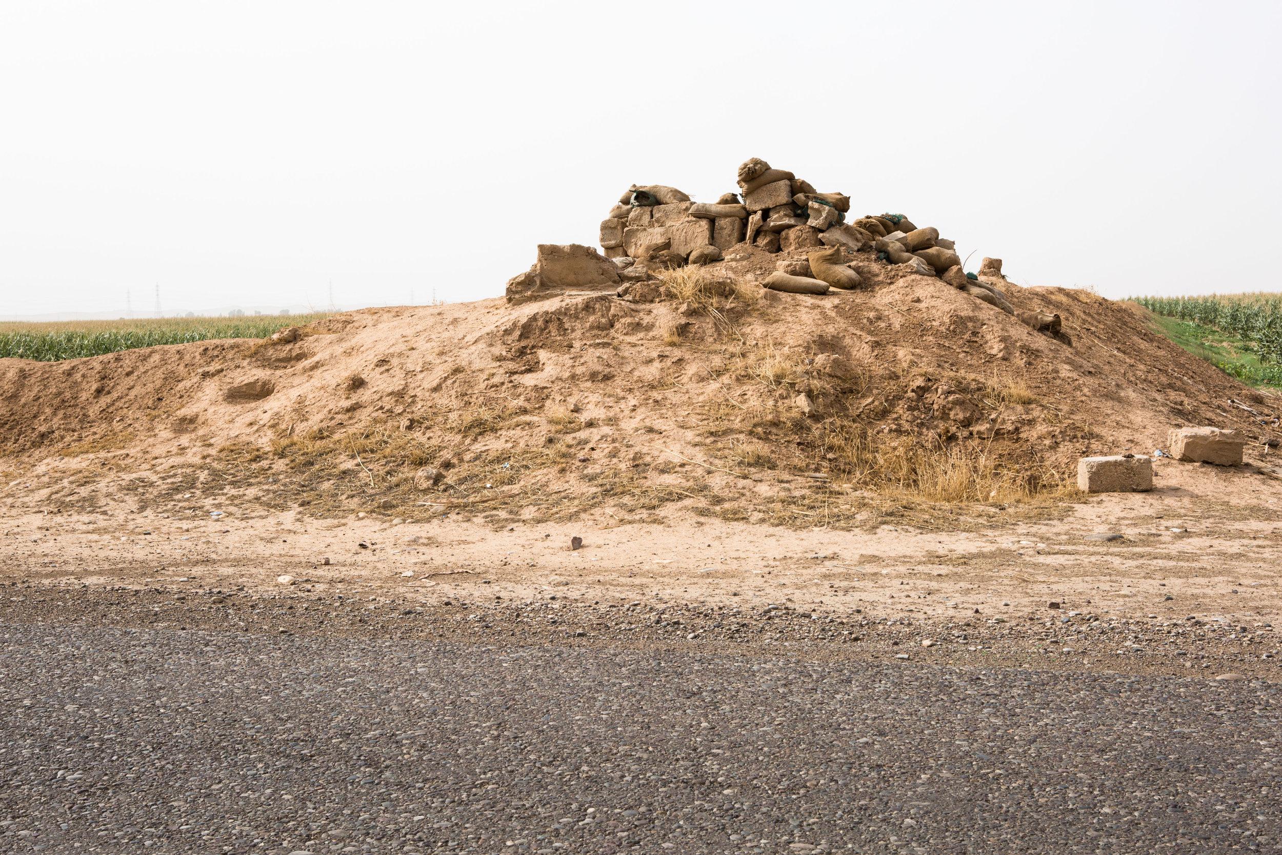 A Peshmerga defensive position cuts through a cornfield outside the village of Chakhmakha.