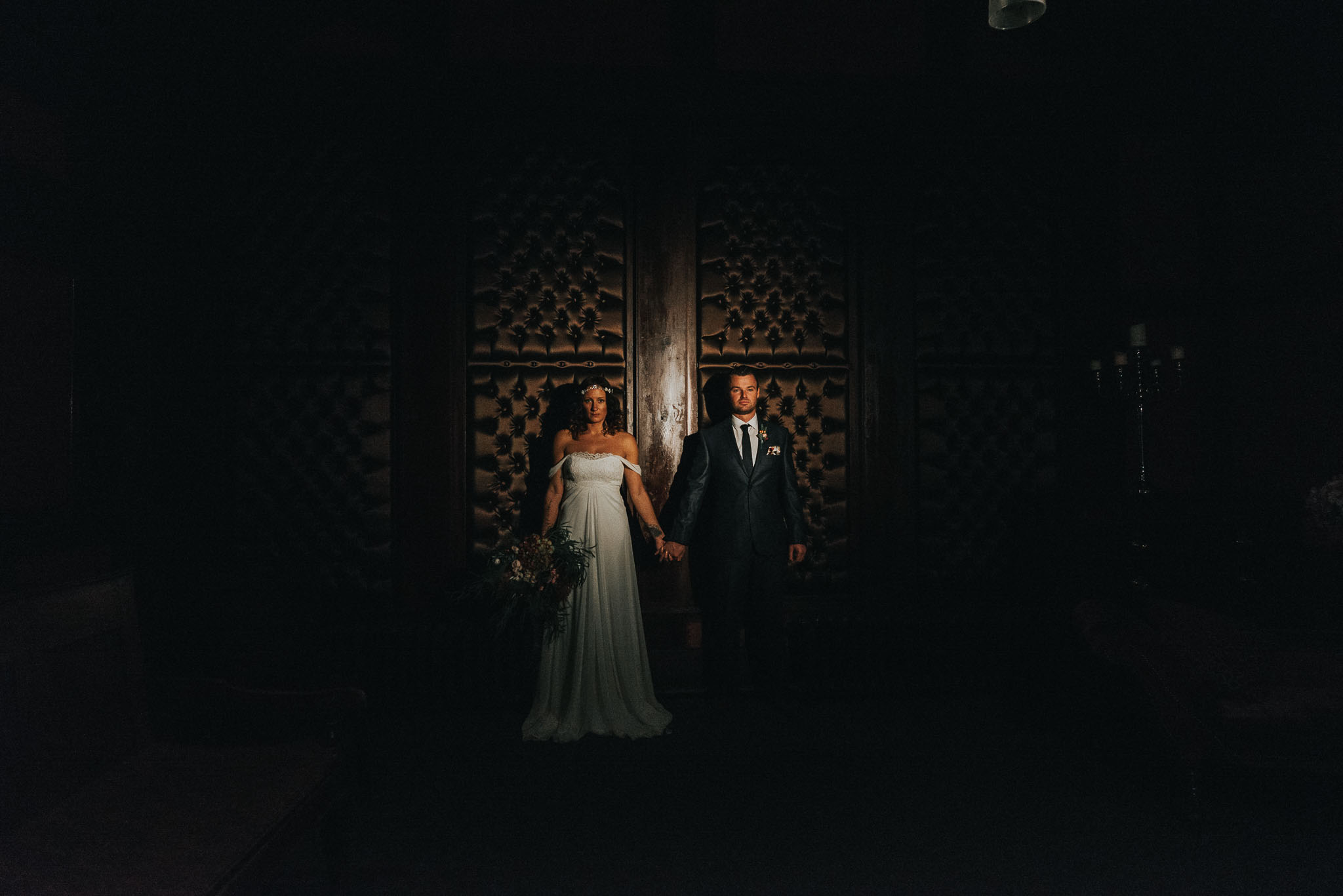 dramatic ceremony image of bride and groom in belle époque in Manchester for their dramatic and moody winter wedding