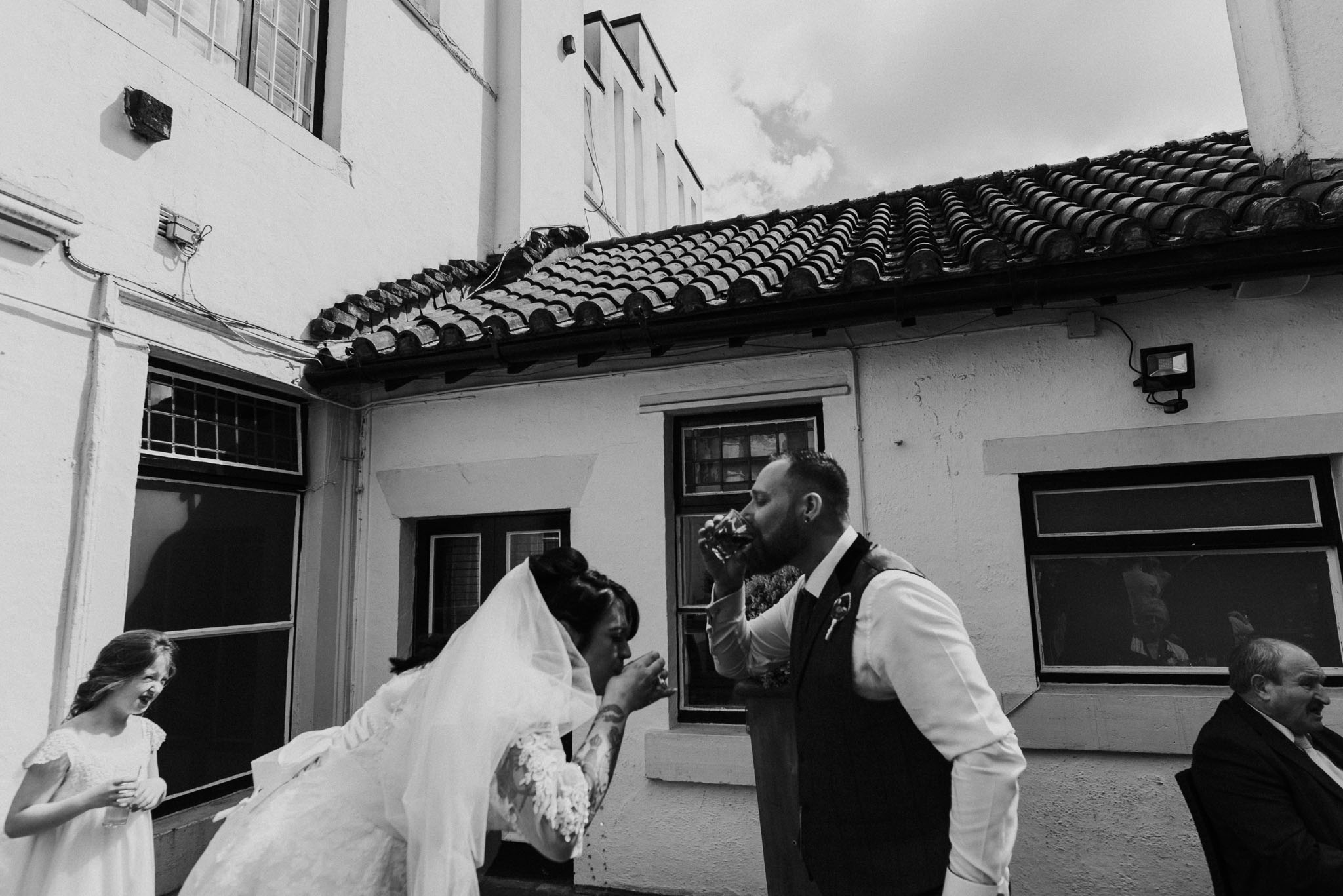 bride and groom drinking jager on wedding day, tattood bride for alternative wedding photography