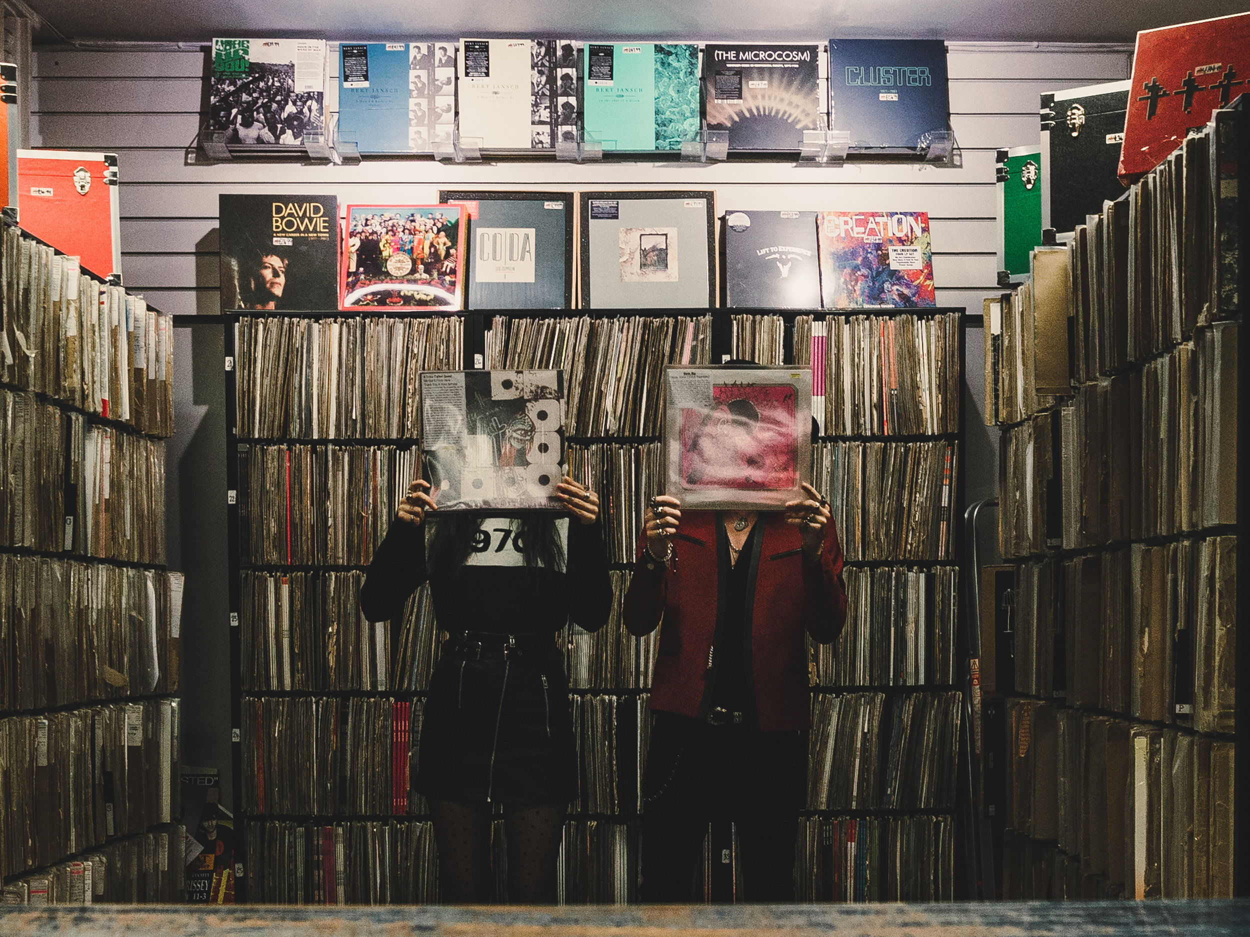 rock fashion bloggers pre-wedding shoot in a record shop in manchester