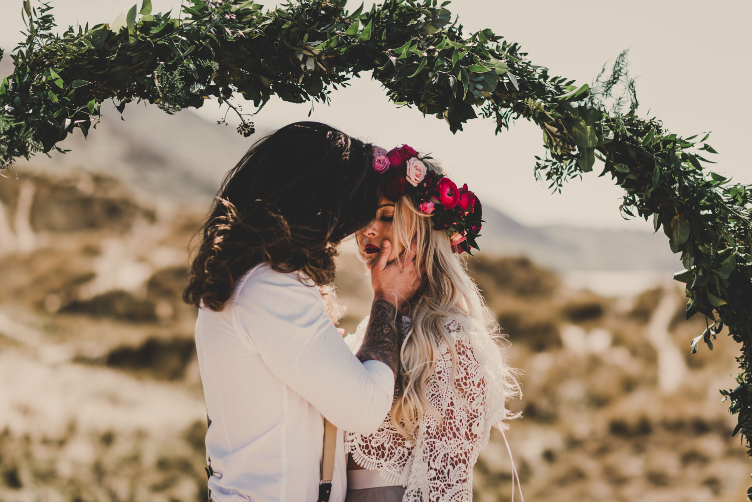 boho edgy couple on a beach for their alternative surfers wedding in south wales