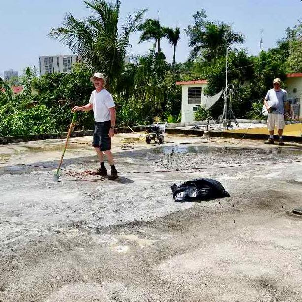 Scrapping and pressure washing to remove all dirt and debris.