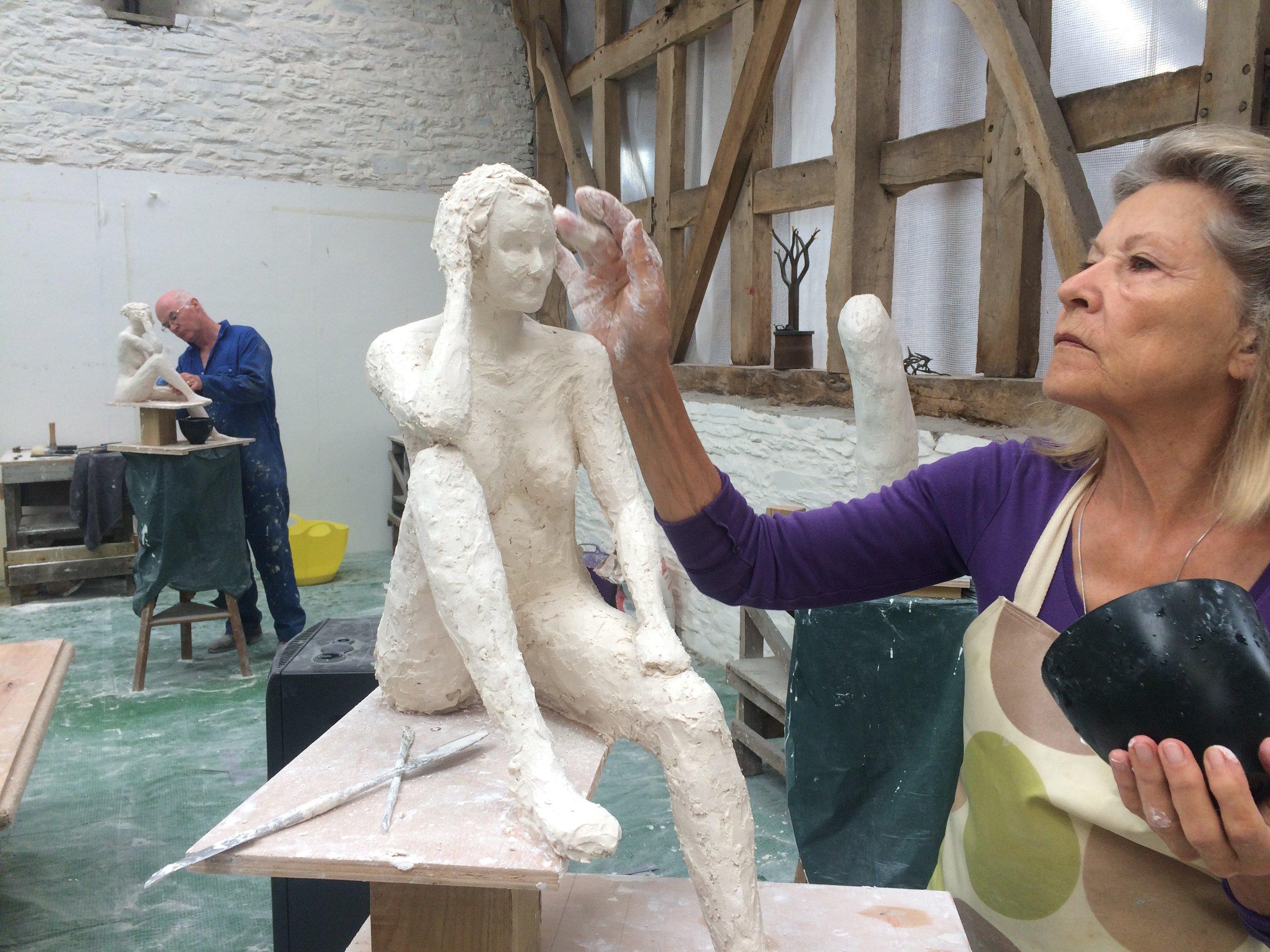 sculpting the figure in plaster