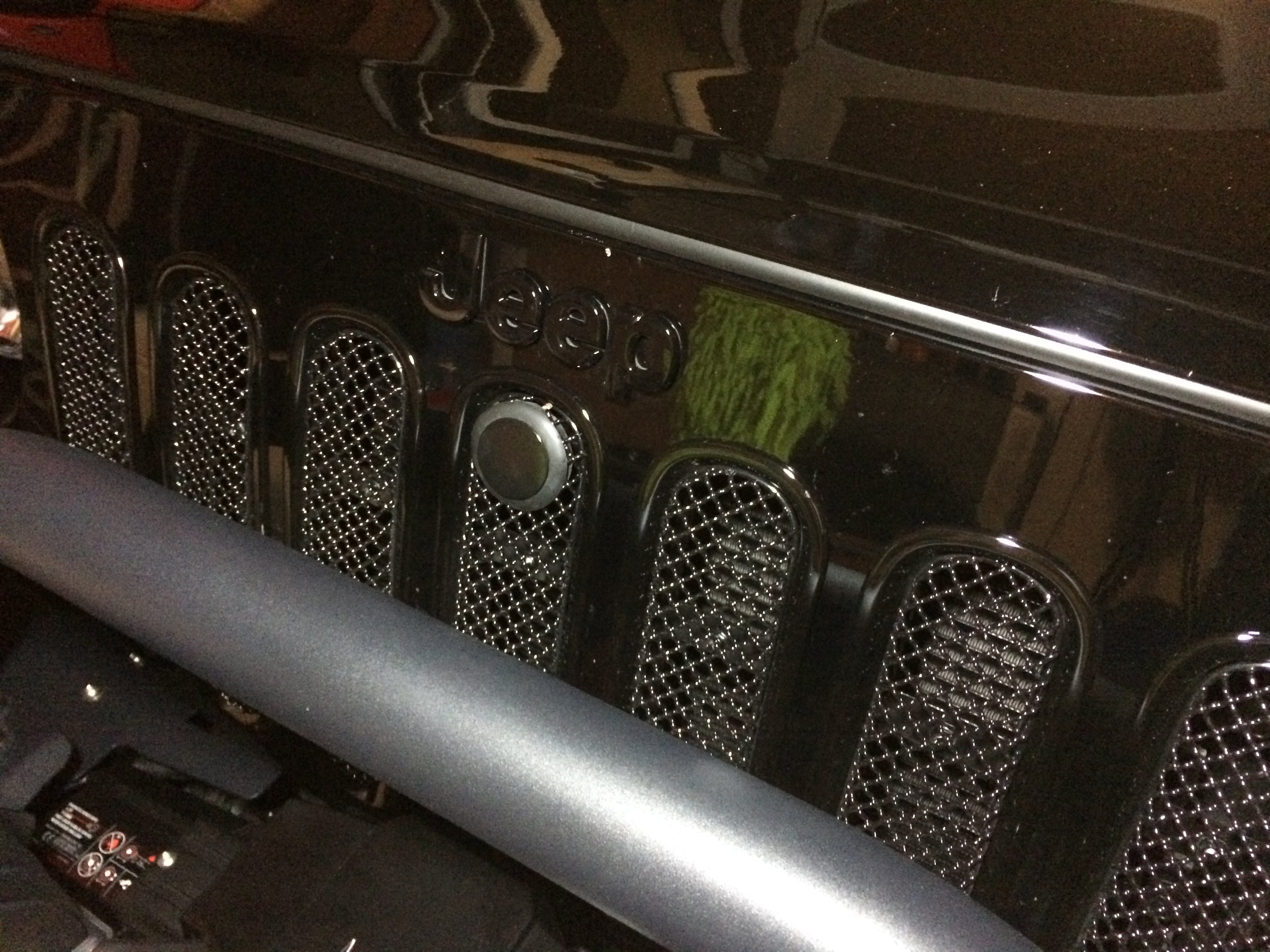 Grill mesh inserts with custom keyhole plug for unlocking the BOLT hood lock.