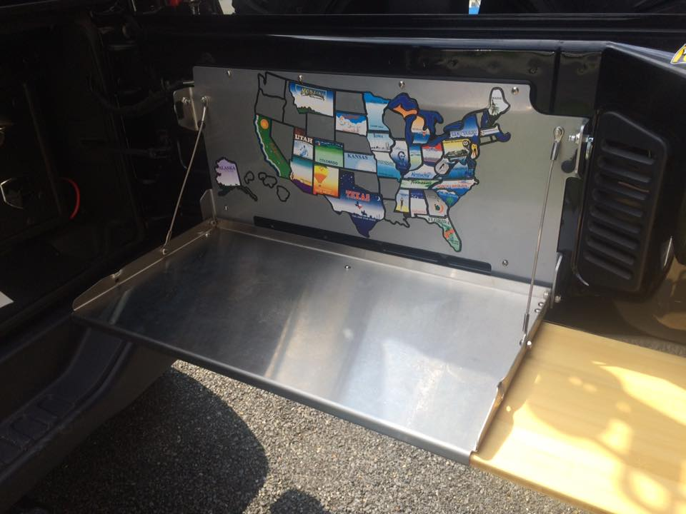 Rebel Off Road tailgate table with bamboo cutting board. States map applied.