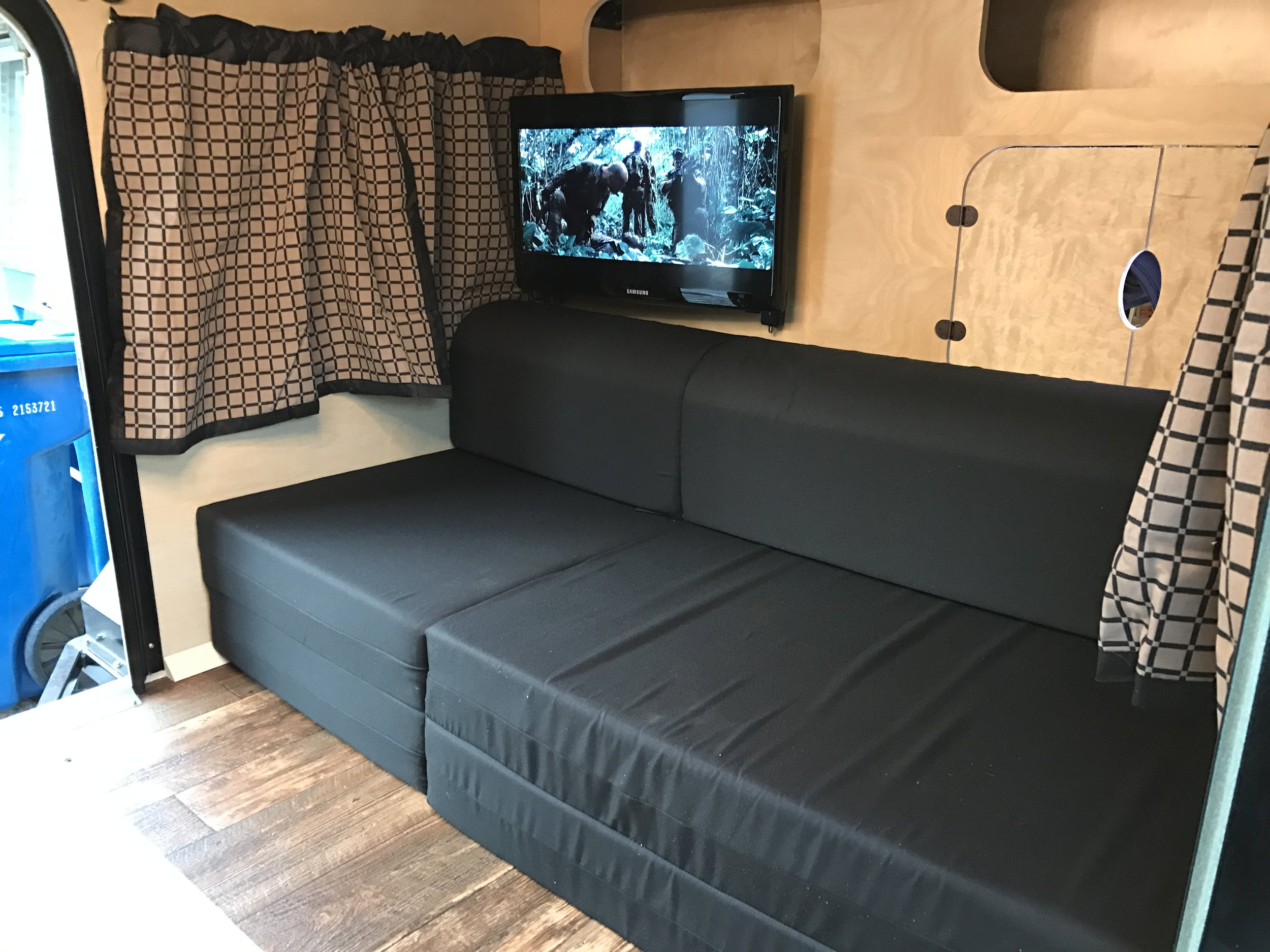 Interior 60/40 split mattress / chairs, Smart TV and curtains.