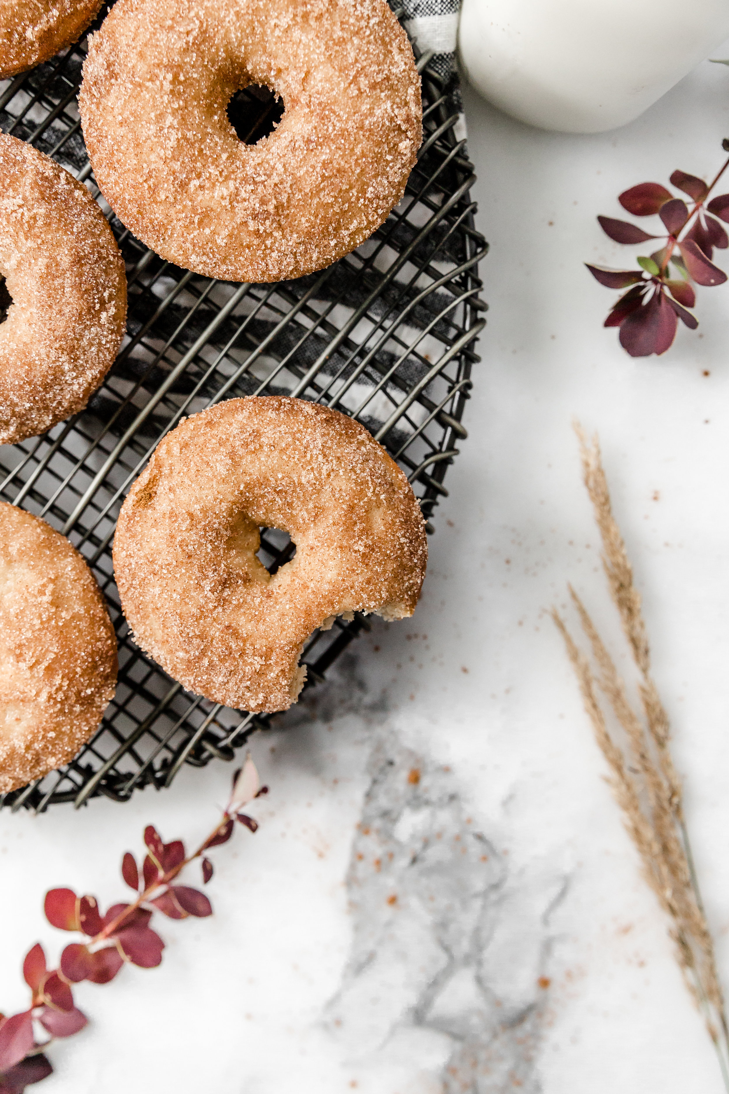 Baked Apple Cider Donuts || To Salt & See. These donuts are made with reduced apple cider to give them their distinct taste. Unlike most donuts, they are not fried, but rather they are baked (read: healthier than regular donuts). Once baked these donuts are coated with melted butter and cinnamon sugar. They are very easy to make, and are PERFECT for these upcoming crisp days.