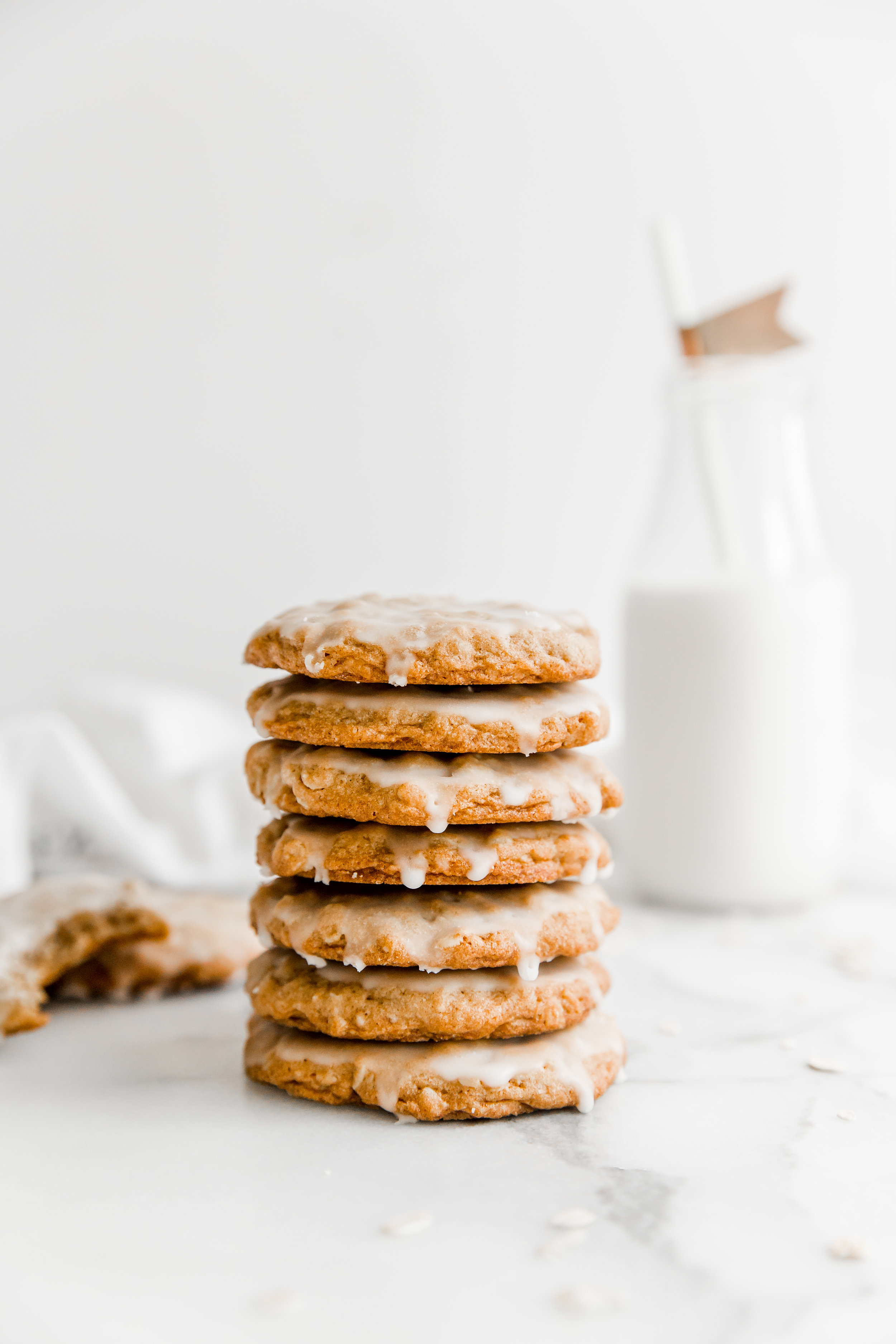Iced Maple Oatmeal Cookies || To Salt & See. These perfectly fall-inspired cookies are easy to make and are a crowd pleaser! They are flavored with maple syrup, cinnamon, and nutmeg - and topped with a maple, powdered sugar icing. These are the perfect treat to enjoy on an overcast, crisp day.