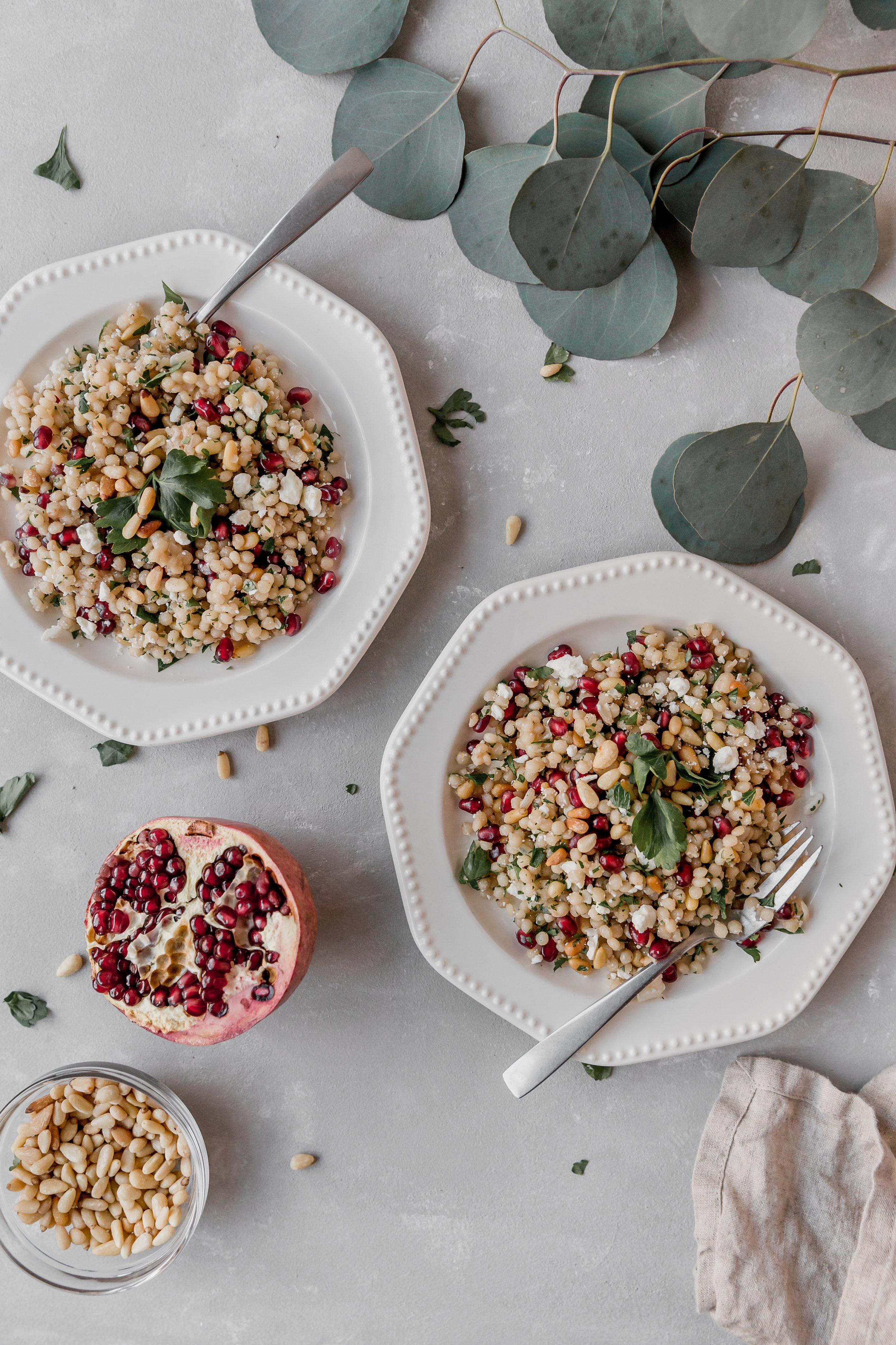 Couscous with Pine Nuts and Pomegranate || To Salt & See. This recipe is healthy, easy to make, and light. The Israeli couscous is combined with pomegranate seeds, feta cheese, minced parsley, and roasted pine nuts.  This is a vegetarian meal, but if you wish to add meat, I suggest some grilled chicken!