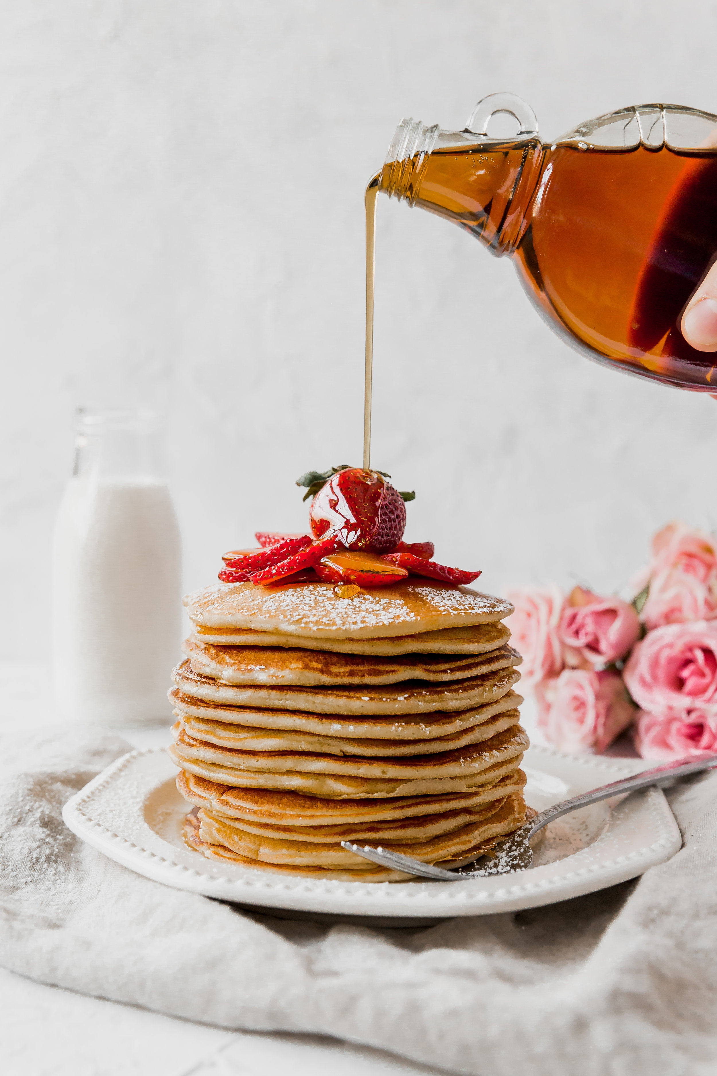 Crème Fraîche Pancakes || To Salt & See. The most perfectly delicious pancakes ever! The crème fraîche adds a rich and creamy flavor to these pancakes. This recipe makes for a wonderful breakfast in bed with that special someone, or with all your gal pals at a Galentine's brunch!