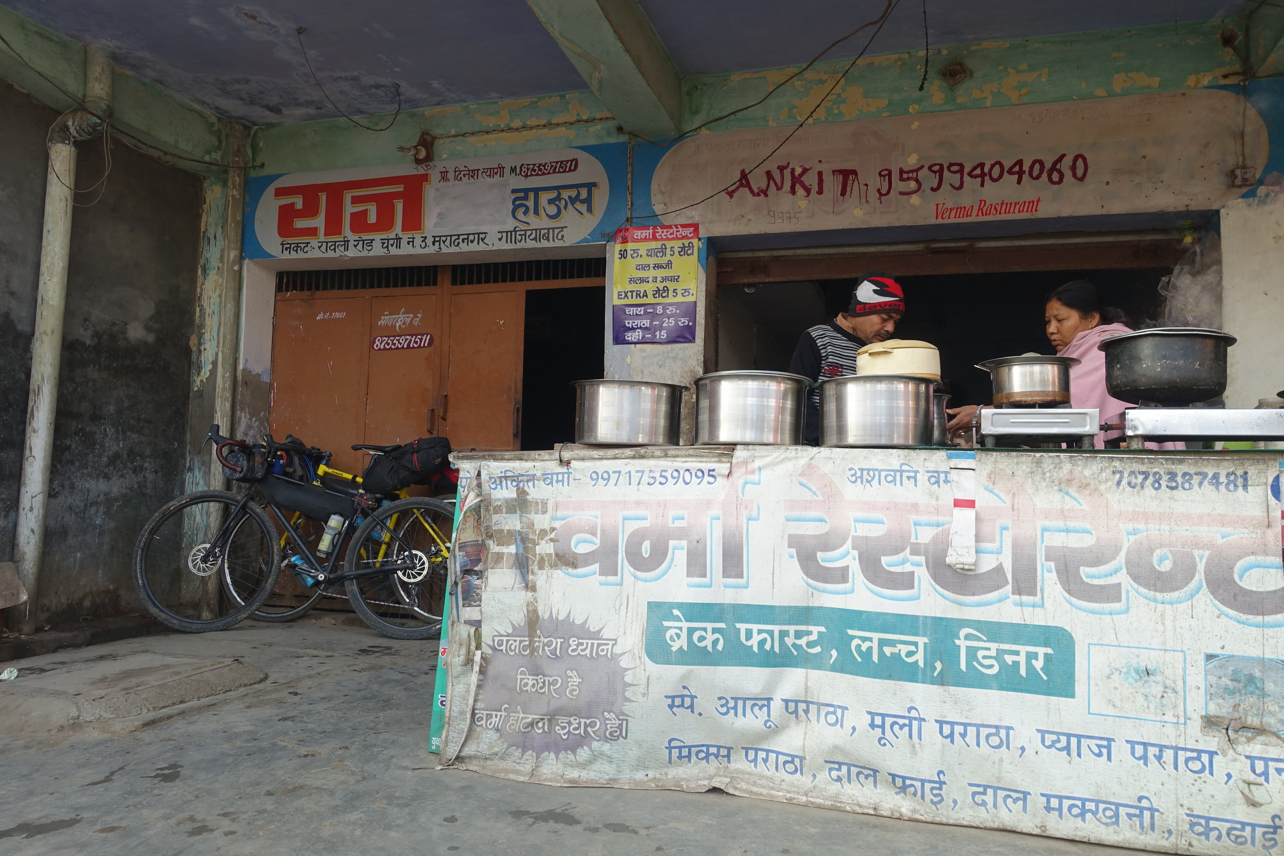 8am breakfast spot. This is a typical rural style food outlet where there isn't a menu and you just get given whatever they make, fresh and to order, right in front you to behold. This time we had stuffed parantha (typical Indian flatbread)with paneer (cottage cheese), onions and chillies. And of course chai. We went through endless chai.