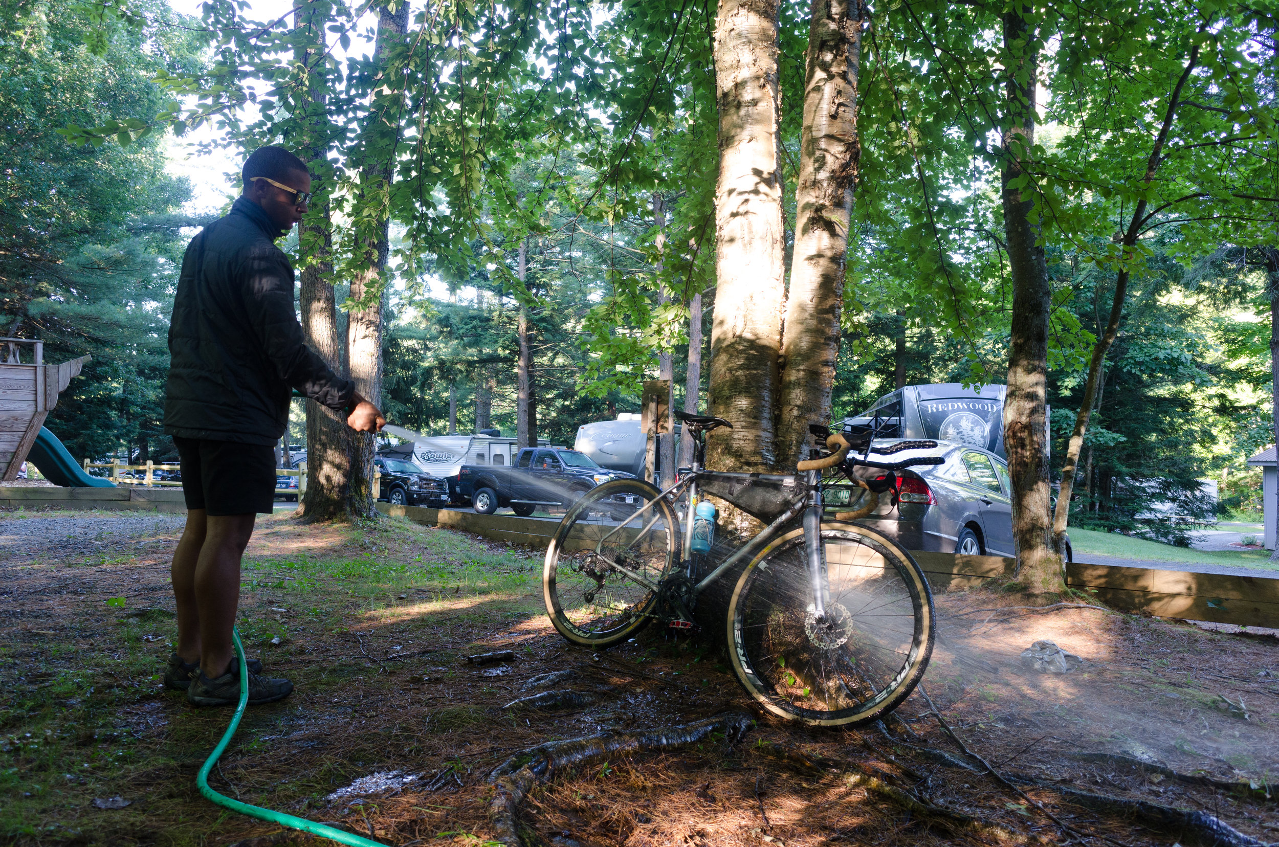 After a night by the fire it was time to rinse yesterday's road debris from our bikes and hit the road again.