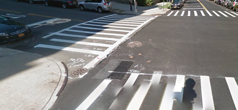 Corner three (Claremont and 122nd Street) looking North - notice two manhole covers and a grate on the inside of the corner.