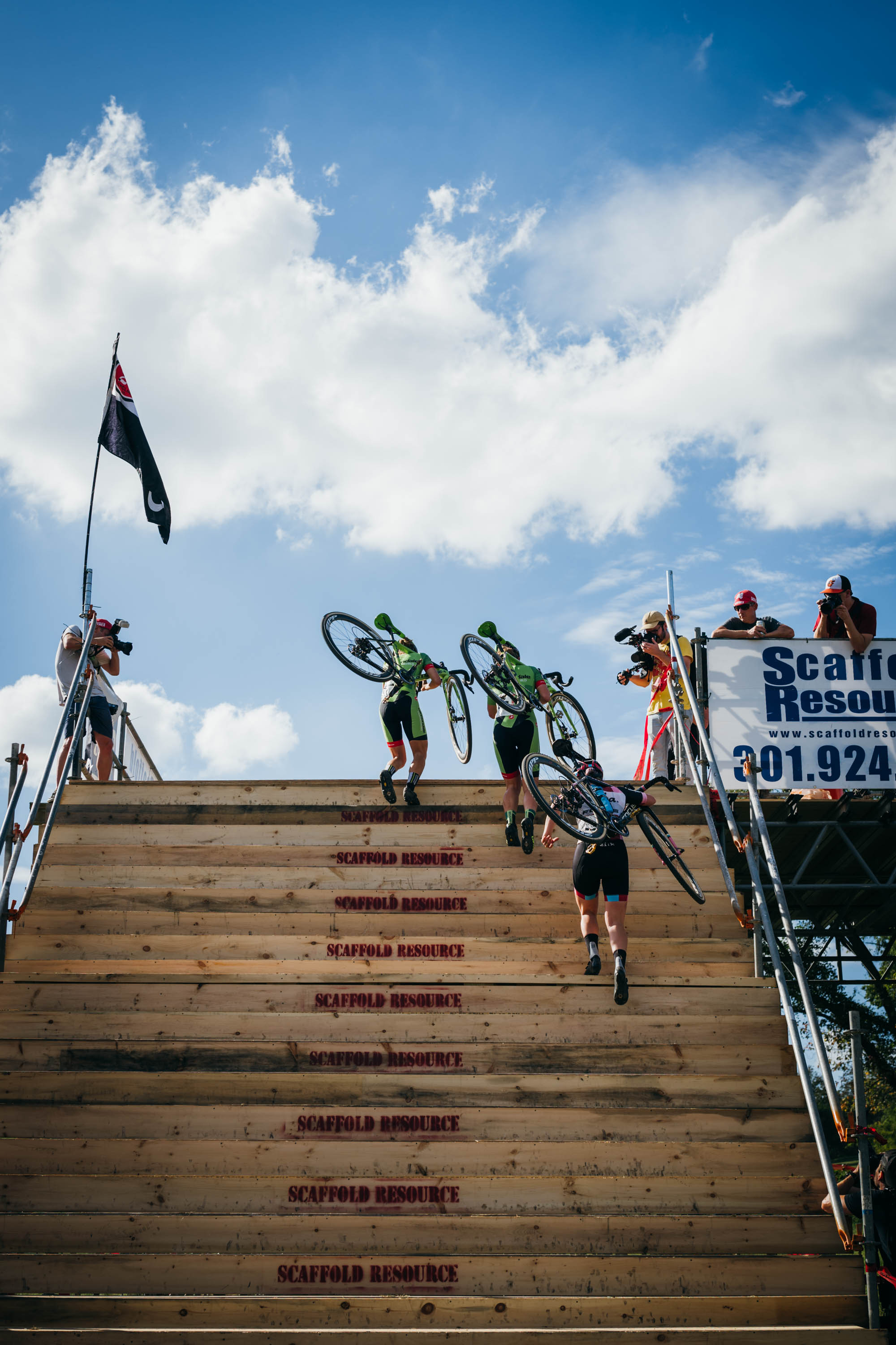 The front end of Saturday's Elite Women's race on their way up the massive flyover at Charm City CX.