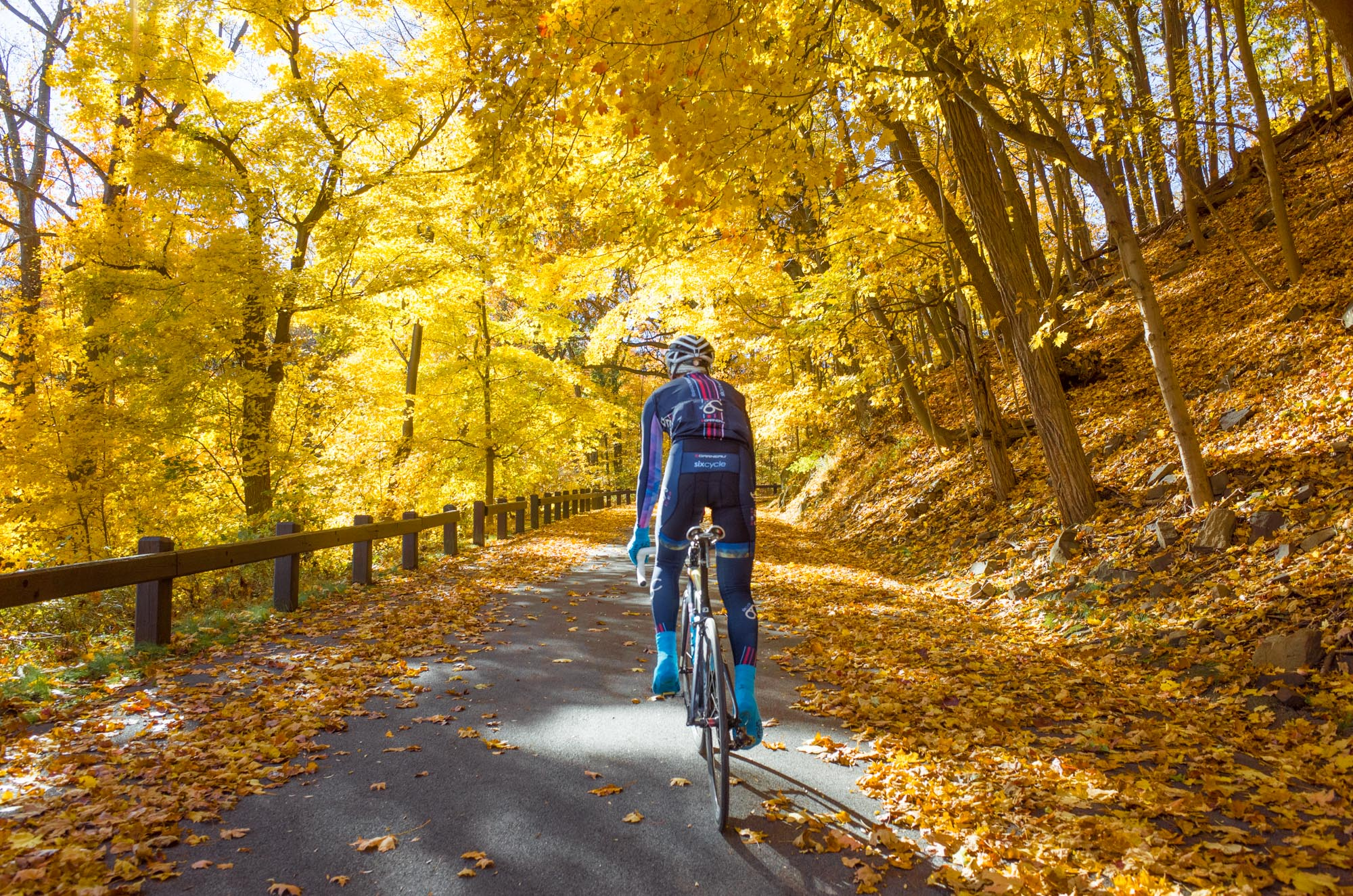 Ollie Davis, who has since relocated to Colorado, in Tallman State Park circa 2014 on one of the many fall team rides focused on finding the best color available within riding distance of Manhattan.