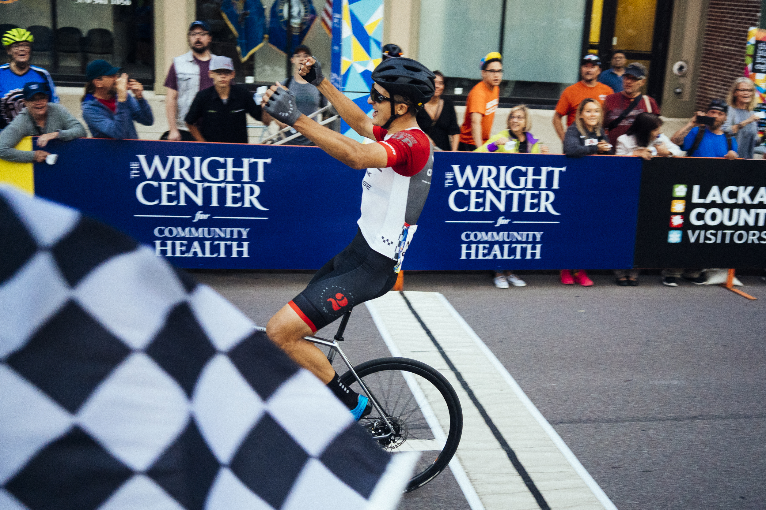 Bryan Gomez crosses the line on Wyoming Ave to take the Pro win