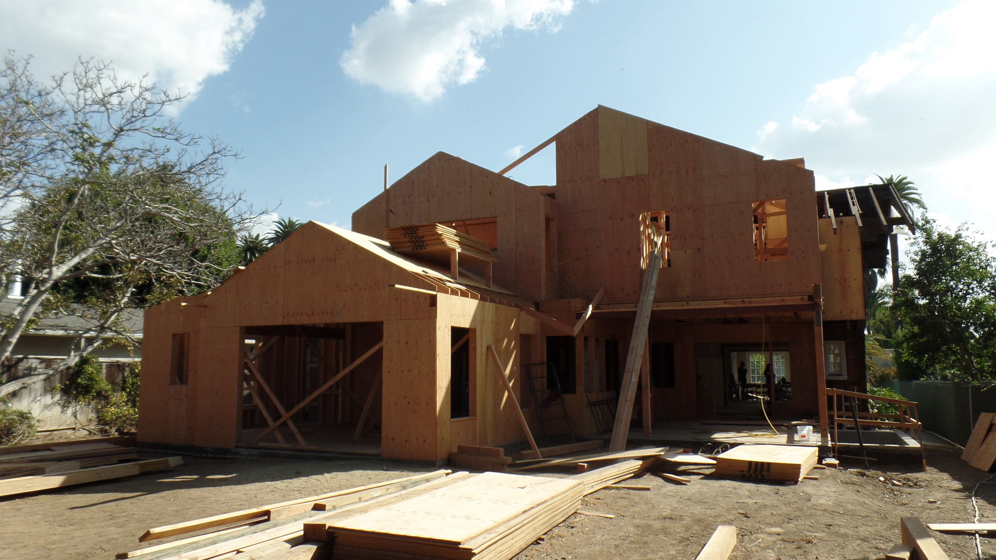 The addition takes shape, adding new family areas to the first floor, a new bedroom to the second floor, and play areas plus a guest suite to the basement.