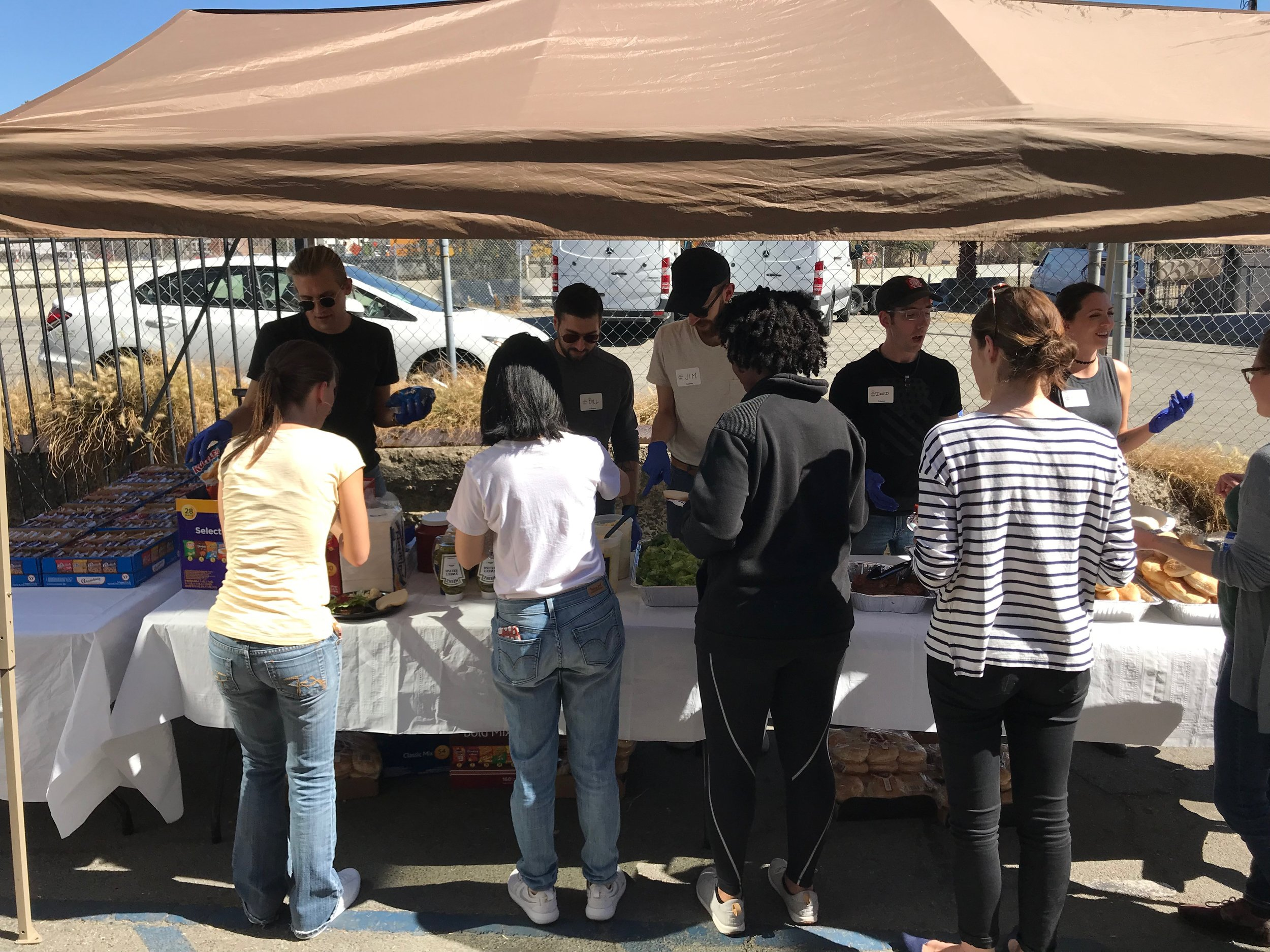 Members of our team preparing to serve lunch at  My Friend's Place  in Los Angeles.
