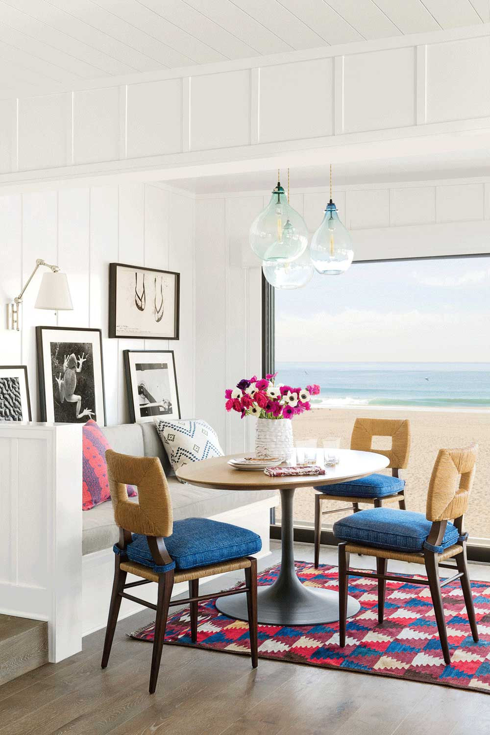 A breakfast nook in a Pacific Ocean-front house in Hermosa Beach, designed by Los Angeles residential architecture firm Tim Barber Ltd. and Peter Dunham Interior Design.