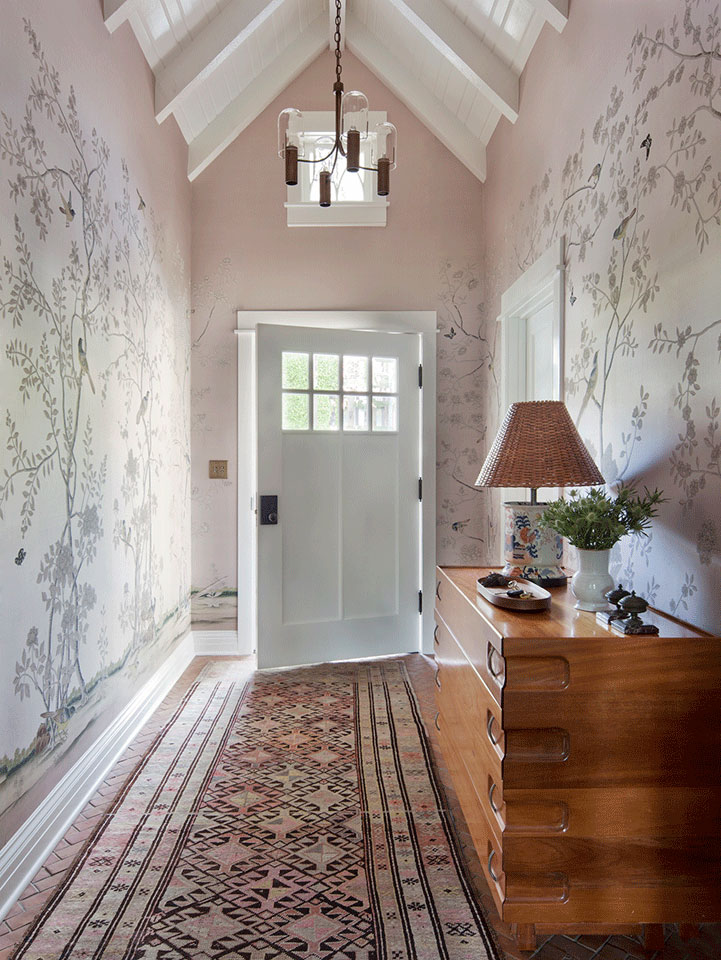 The entry hall of a traditional style cottage in Pacific Palisades, designed by Los Angeles residential architecture firm Tim Barber Ltd. and Kristen Panitch Interiors.