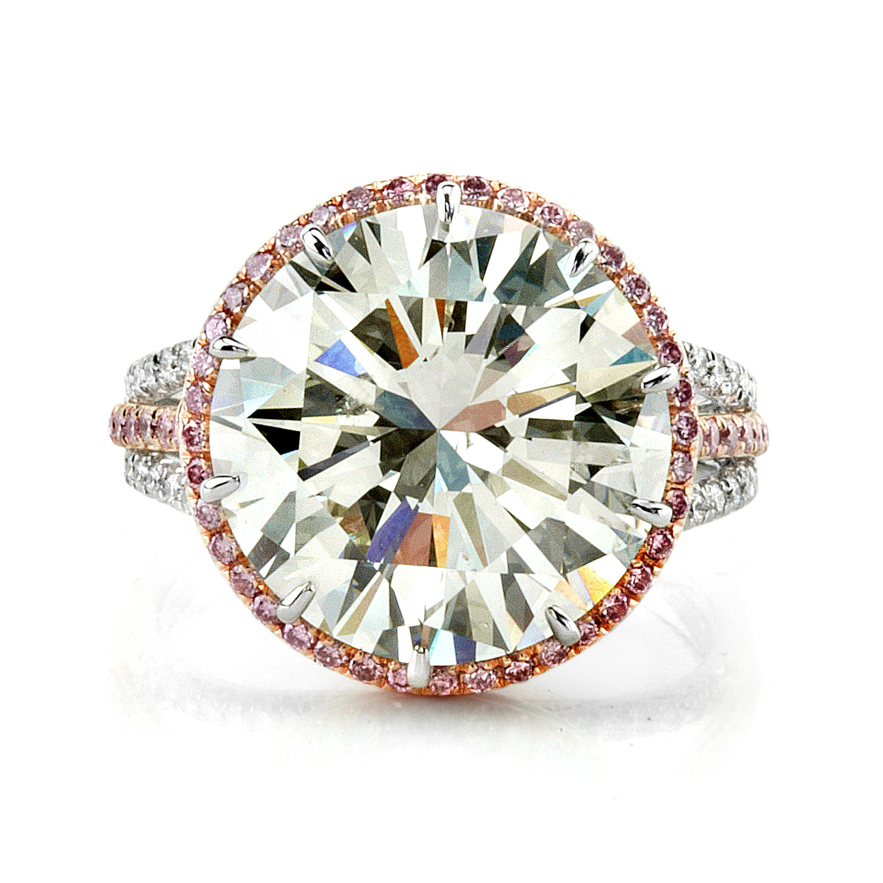 VICE  oversized round brilliant diamond placed in a ten-prong platinum and rose gold setting. This design features a narrow halo of natural fancy pink diamonds around the center diamond, as well as a triple shank band which showcases this diamond in a magnificant way.