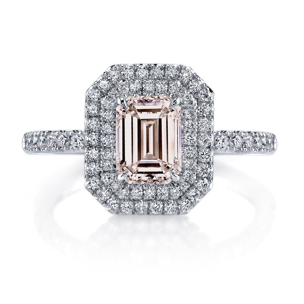 BLUSH   natural fancy pink emerald cut diamond set in a platinum double halo setting. This design features two narrow rows of french pave set accent diamonds around the center diamond. The color of this diamond resembles the beauty of falling in love.