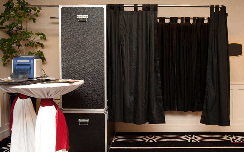 The booth is fully enclosed with a curtain, full color touch screen to guide your guests through the photo process, option of color or black & white prints along with your names and wedding date on each photo strip. There is also a dedicated photo booth operator that will be there to help your guests.