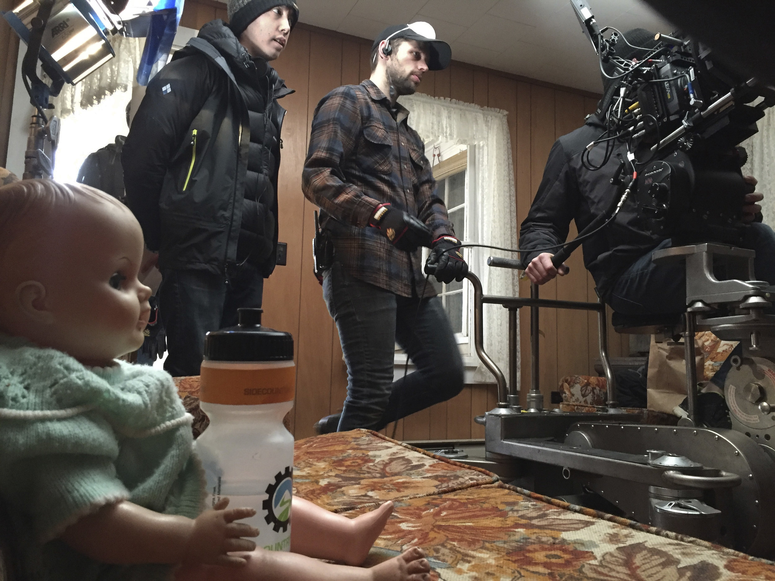Director Josh Gerritsen and dolly grip Adam Belanger in the abandoned house