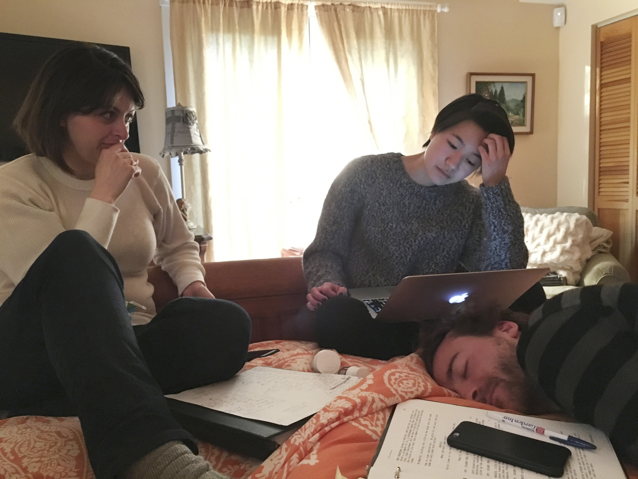 Producer Mariah Klapatch, line producer Candice Kuwahara, and DP Mark Farney work on the next day's schedule