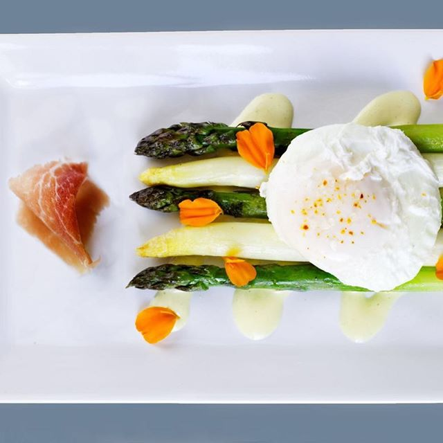 Roasted Asparagus, Egg Yolk Vinaigrette, Poached Egg, and Shaved Presunto  This dish is all about the egg, which makes it a great springtime salad. The egg yolk vinaigrette is one of our favorite parts of this dish. It's essentially sherry vinaigrette with plenty of cooked egg yolks pureed into it. Join us this weekend. #portuguesefood #sonomavalley #springtime