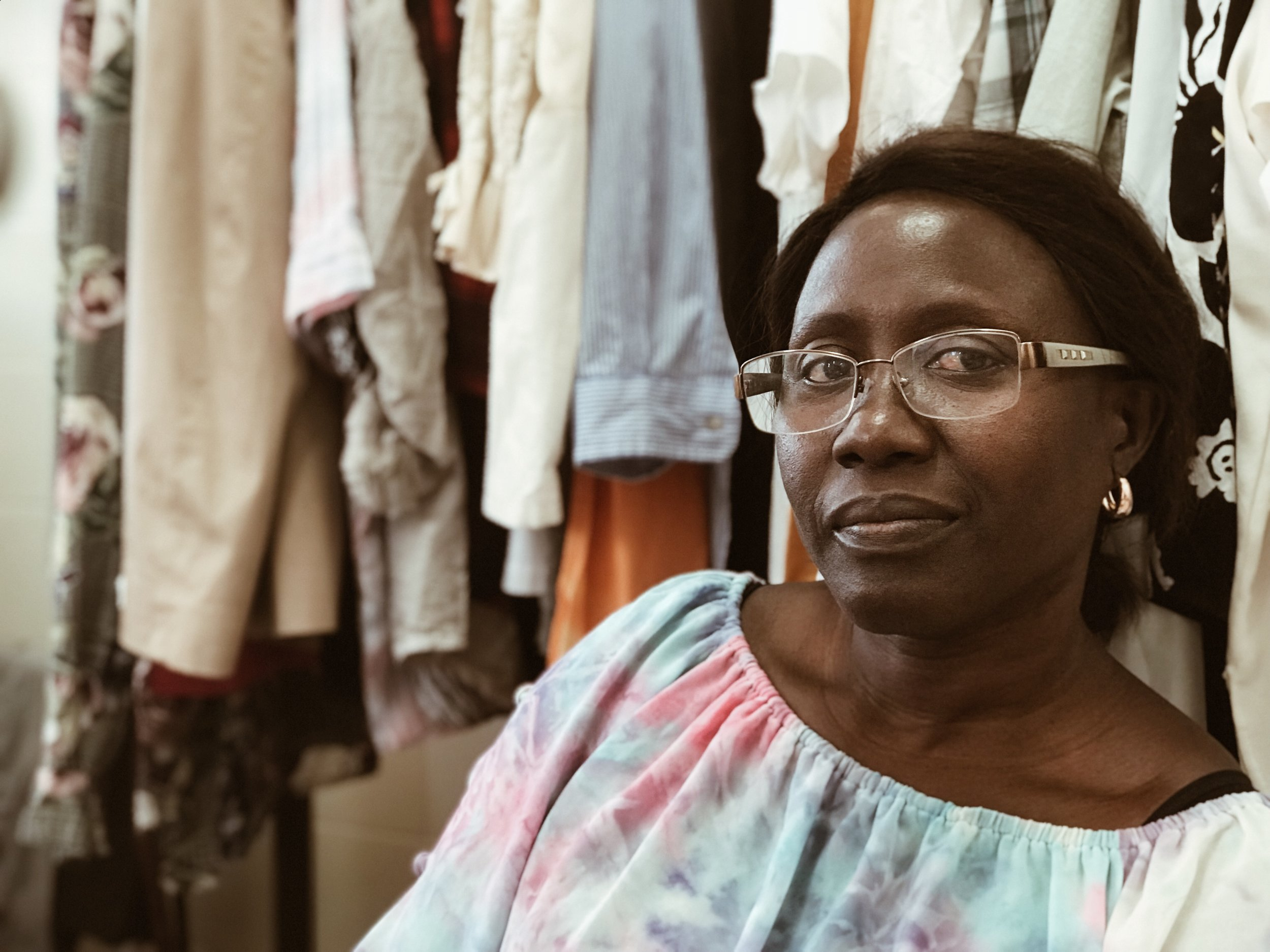 Nené, long-time client, often stops by the store to hang out with the volunteers.