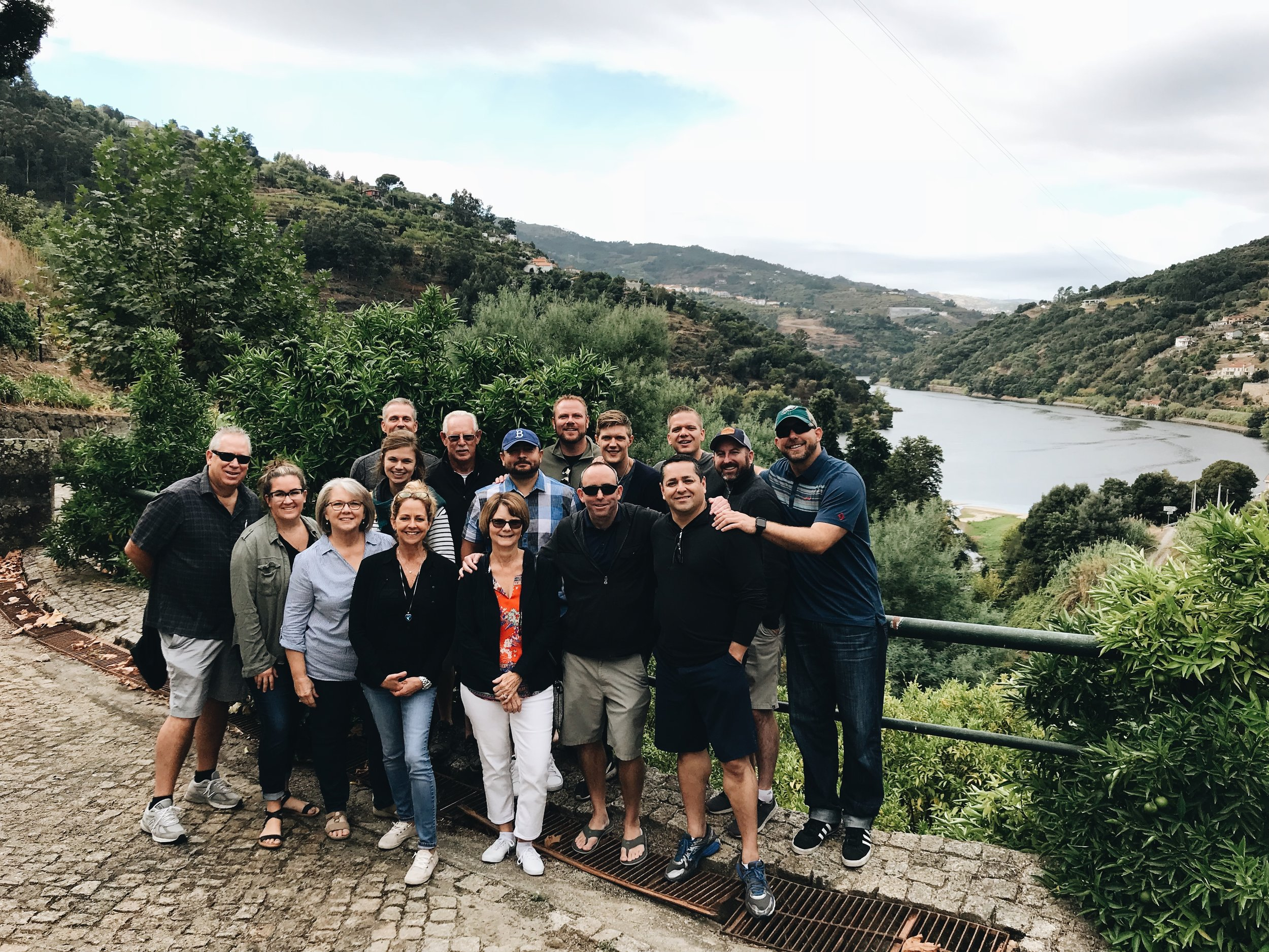 October Fall Trip 2018 attendees pose in front of the Douro river outside Quinta da Ermida in northern Portugal.