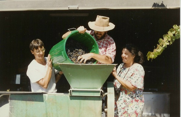 Tony Haigh, myself and Rhonda feeding a precious bucket of Bloodwood fruit into the crusher. Winemaking is a communal activity, particularly in the early stages. Even the crusher in this bucolic scene is borrowed from the Holmes' Glenfinlass vineyard in Wellington.