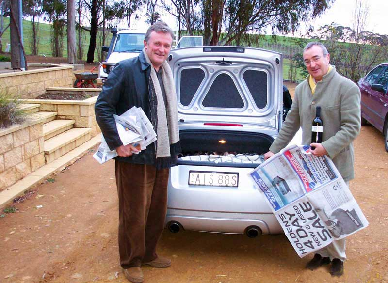 Broadsheets still have a use  Attention - this is not a holden..and it doesn't fit standard wine cartons in the boot. But do not fear, if you have a few blankets and a supply of broadsheet newspapers you can singly pack an impressive number of bottles in even this boot. The trick is to wrap each bottle individually and position a blanket between each layer of bottles.  You wouldn't read about it.