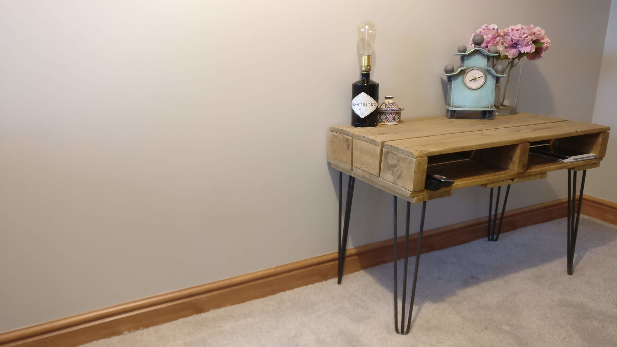 Pallet table with hairpin legs and Hendricks Gin lamp
