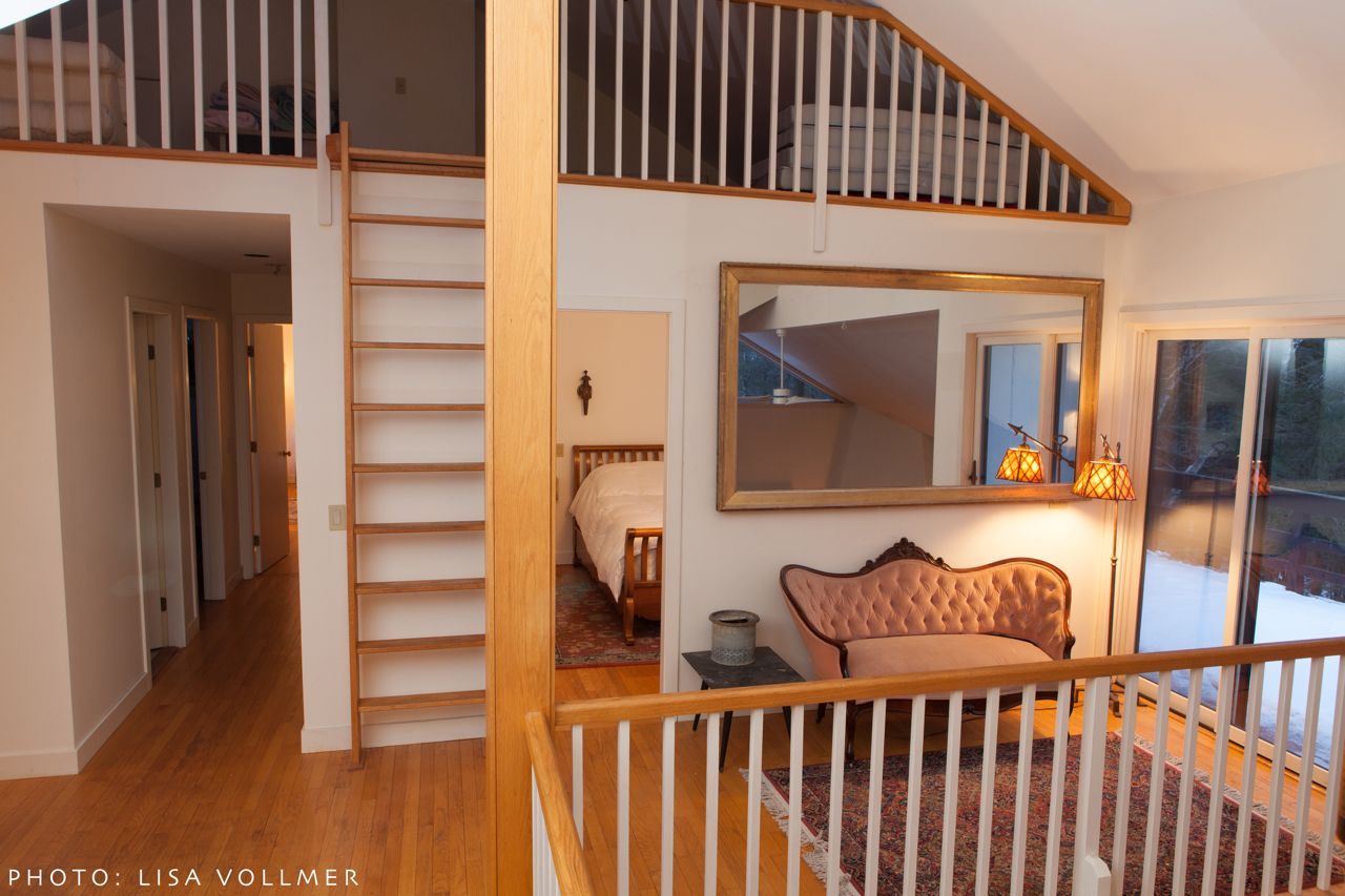 Ladder to loft and hallway at Race Mountain House